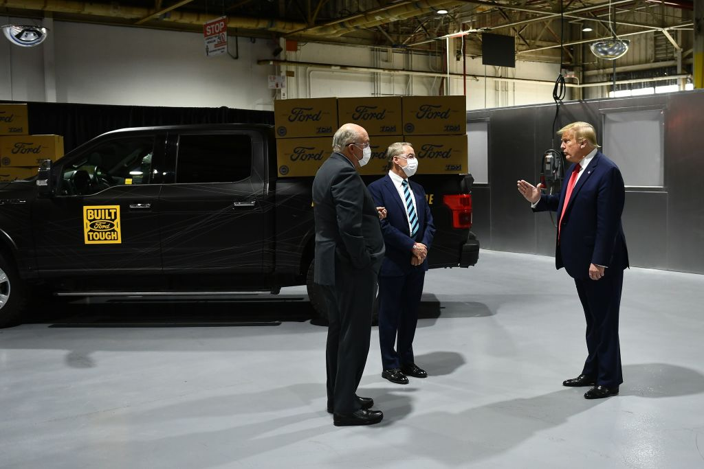 Ford Motor Company CEO Jim Hackett (L) speaks with US President Donald Trump as they toursthe Ford Rawsonville Plant in Ypsilanti, Michigan on May 21, 2020.