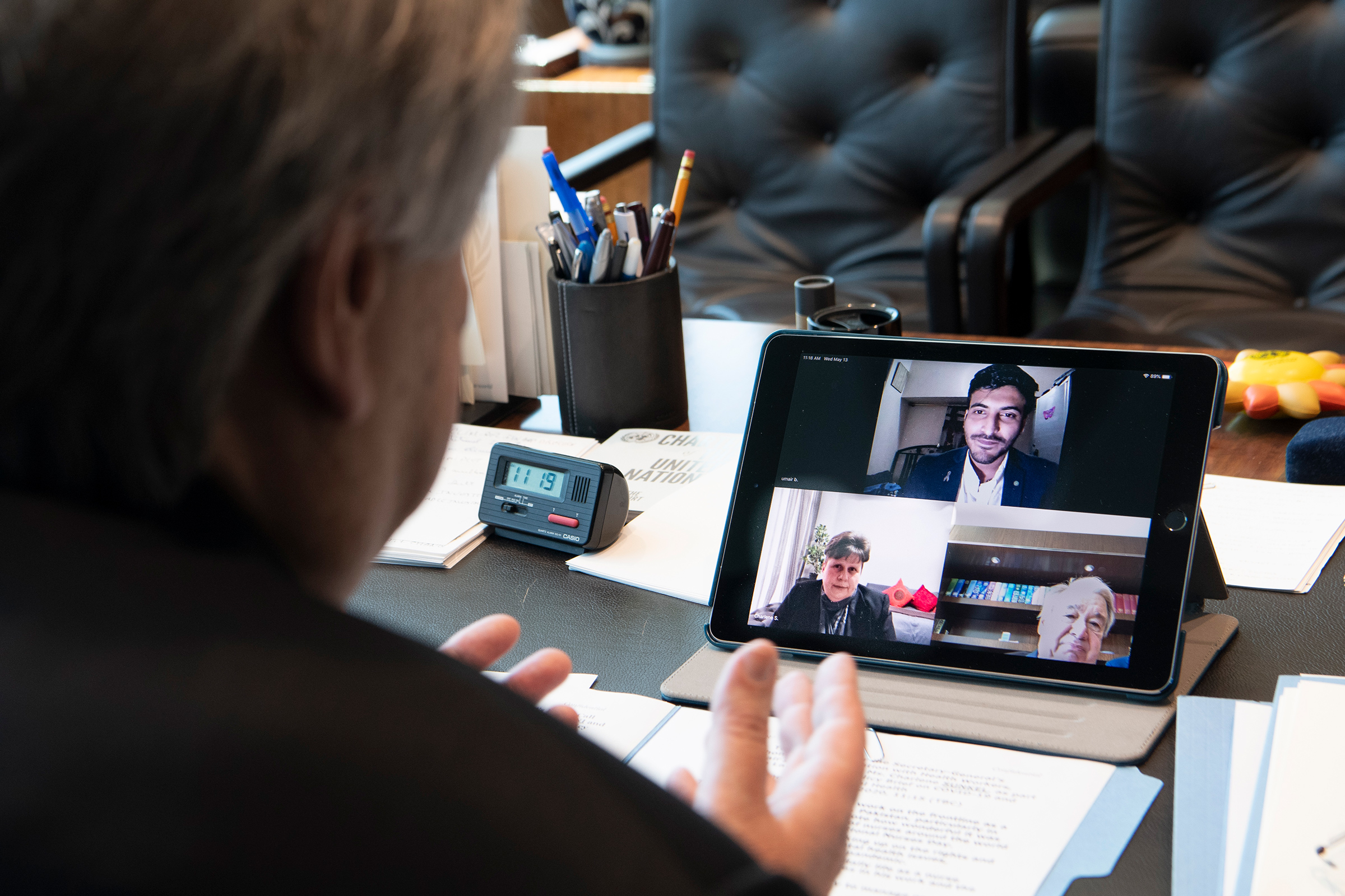 Guterres in a three-way video call with frontline mental health workers, Mr. Umair Bachlani in Pakistan and Ms. Charlene Sunkel in South Africa.