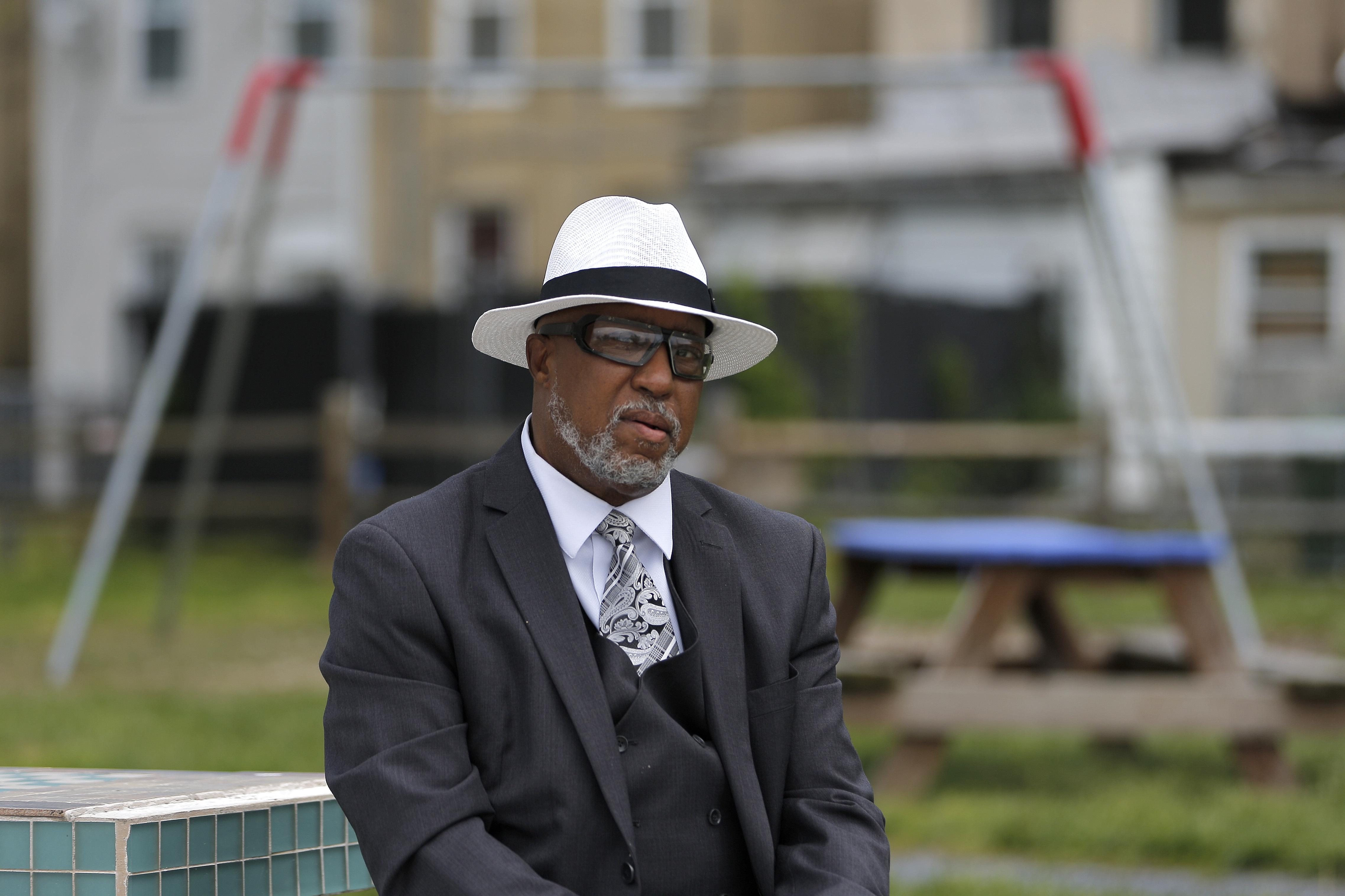 In this April 29, 2020 photo, Marvin L. Cheatham Sr., who led his local NAACP chapter in the 1990s, poses in the park he built in West Baltimore following the riots sparked from the 2015 arrest of Freddie Gray.