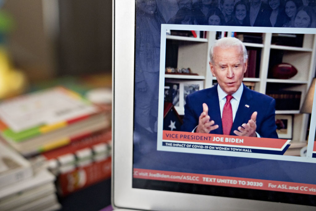 Former Vice President Joe Biden, presumptive Democratic presidential nominee, speaks during a virtual event seen on a laptop computer in Arlington, Virginia, U.S., on Tuesday, April 28, 2020. Clinton endorsed Biden today saying that she wishes he were in the White House to lead the country through the coronavirus pandemic.