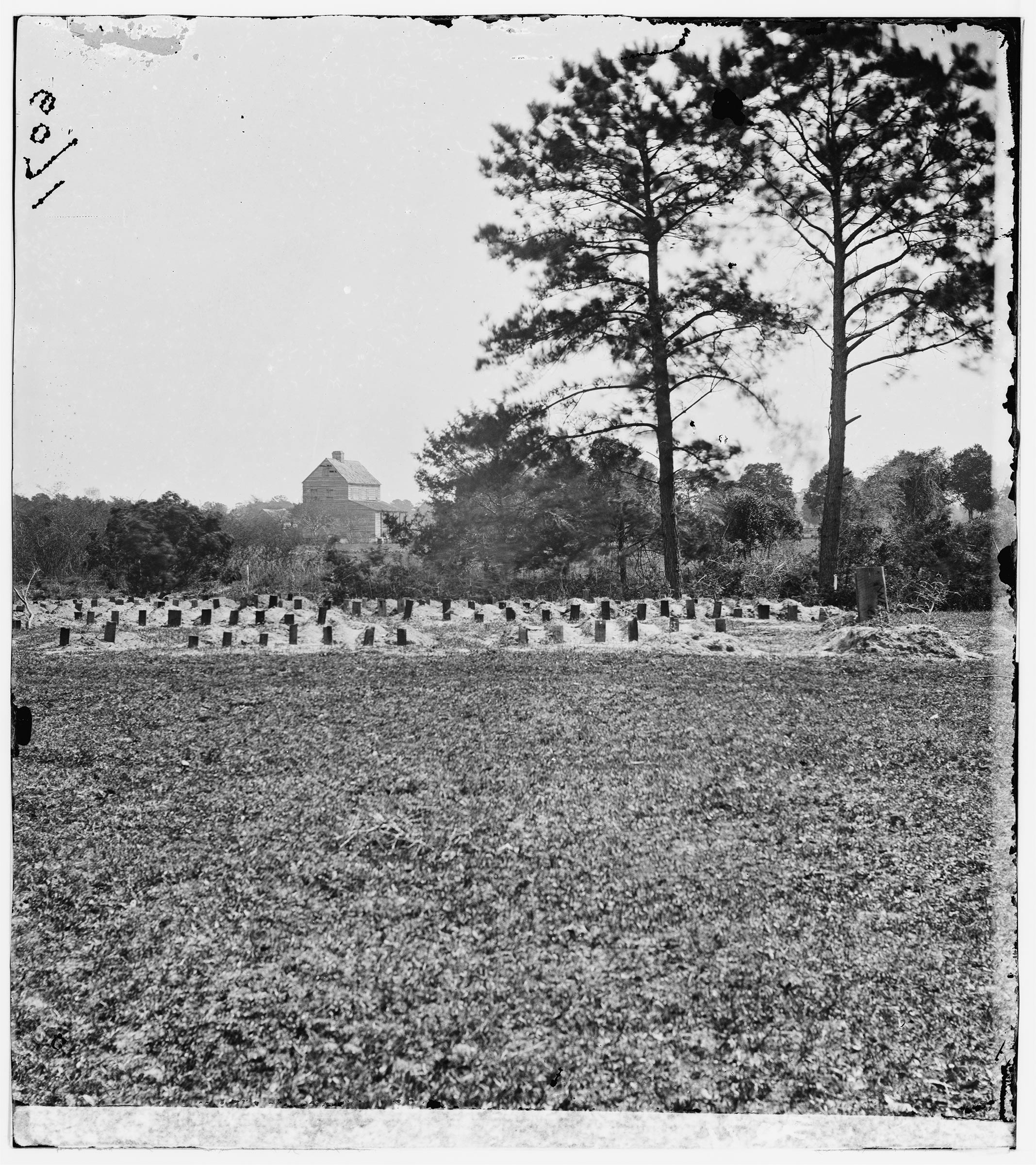 An April 1865 photo of the graves of Union soldiers buried at the race course-turned-Confederate-prison where historians believe the earliest Memorial Day ceremony took place.