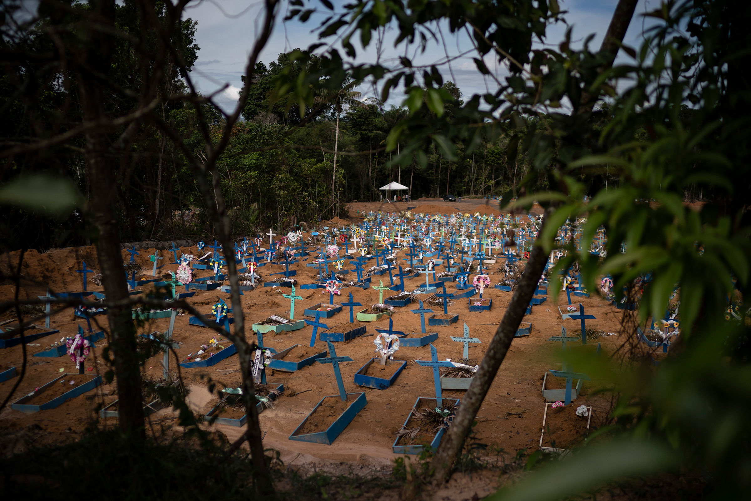 Graves of people who died in the past 30 days fill a new section of the Nossa Senhora Aparecida cemetery in Manaus, Brazil, on May 11, 2020. The new section was opened last month to cope with a sudden surge in deaths.