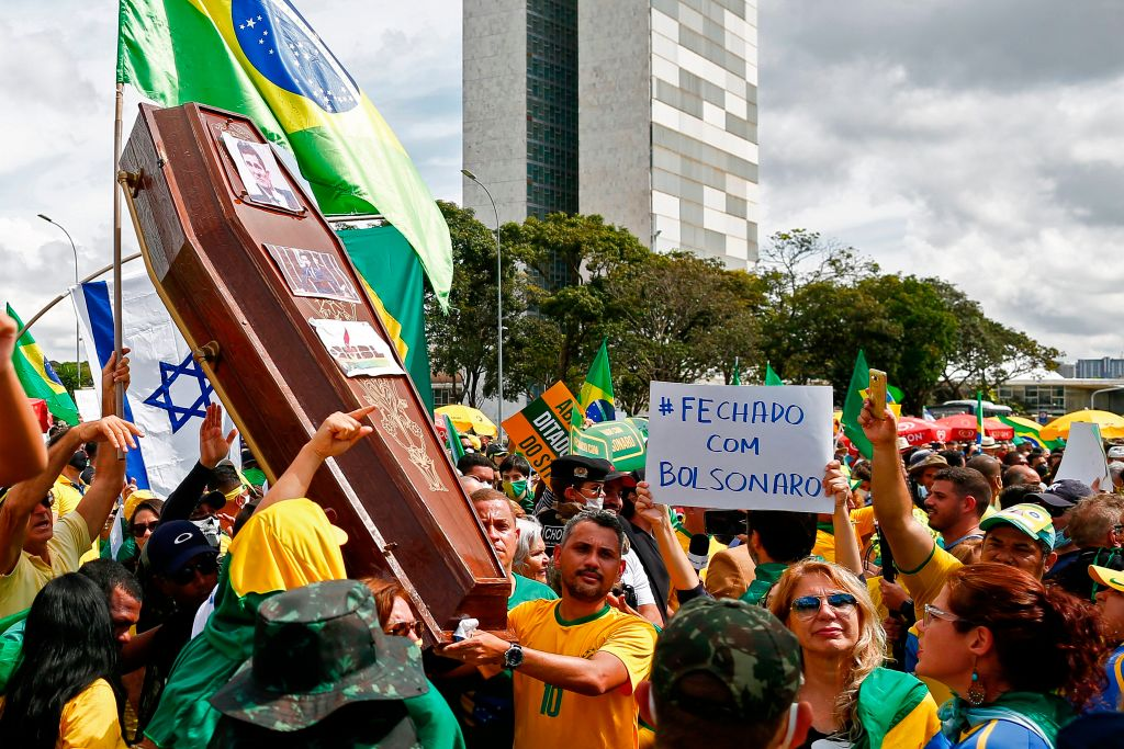 Supporters of Brazilian President Jair Bolsonaro demonstrate with a coffin with the portrait of Brazilian former Justice Minister Sergio Moro, Brazilian and Israeli flags during a rally in Brasilia on May 17, 2020, amid the novel coronavirus pandemic.
