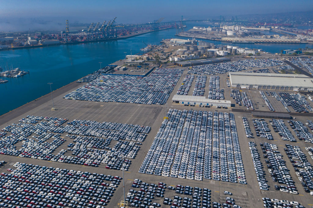 An aerial view shows cars that were offloaded from ships at Wallenius Wilhelmsen Logistics (WWL) as the spread of the coronavirus pandemic cripples the economy on April 26, 2020 in Wilmington, California. The sudden high unemployment crisis is hitting car sales as travel restrictions and widespread social distancing measures continue across most of the nation to fight the coronavirus pandemic.