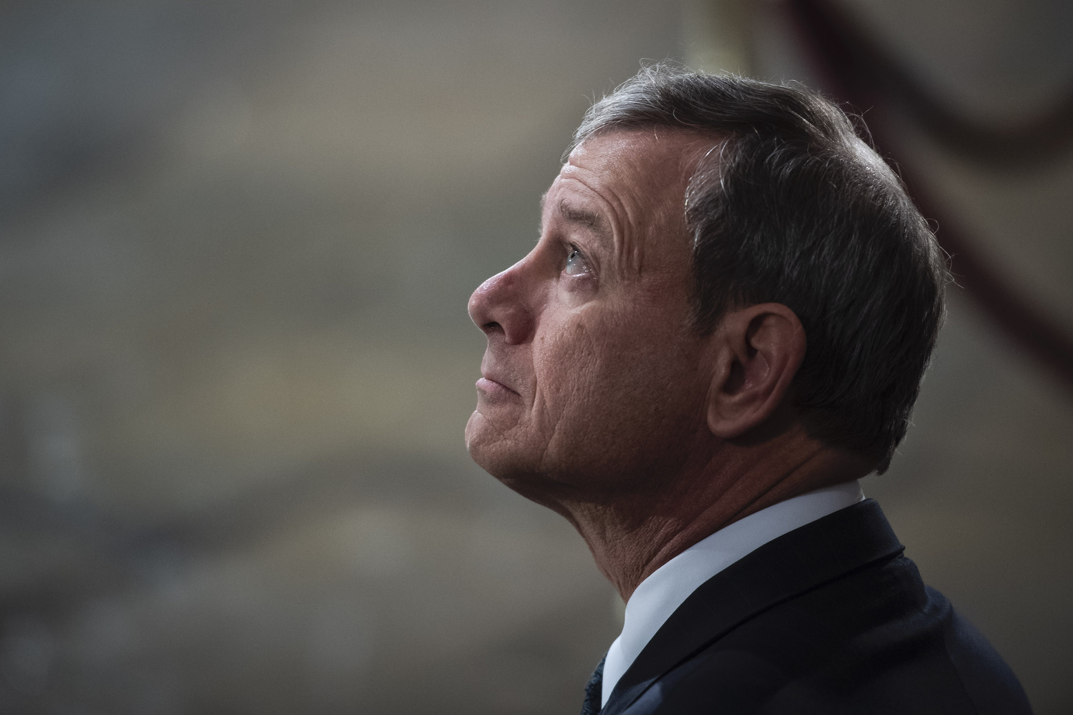 U.S. Supreme Court Chief Justice John G. Roberts, Jr. waits for the arrival of former U.S. President George H.W. Bush at the U.S Capitol Rotunda on December 03, 2018 in Washington, DC.