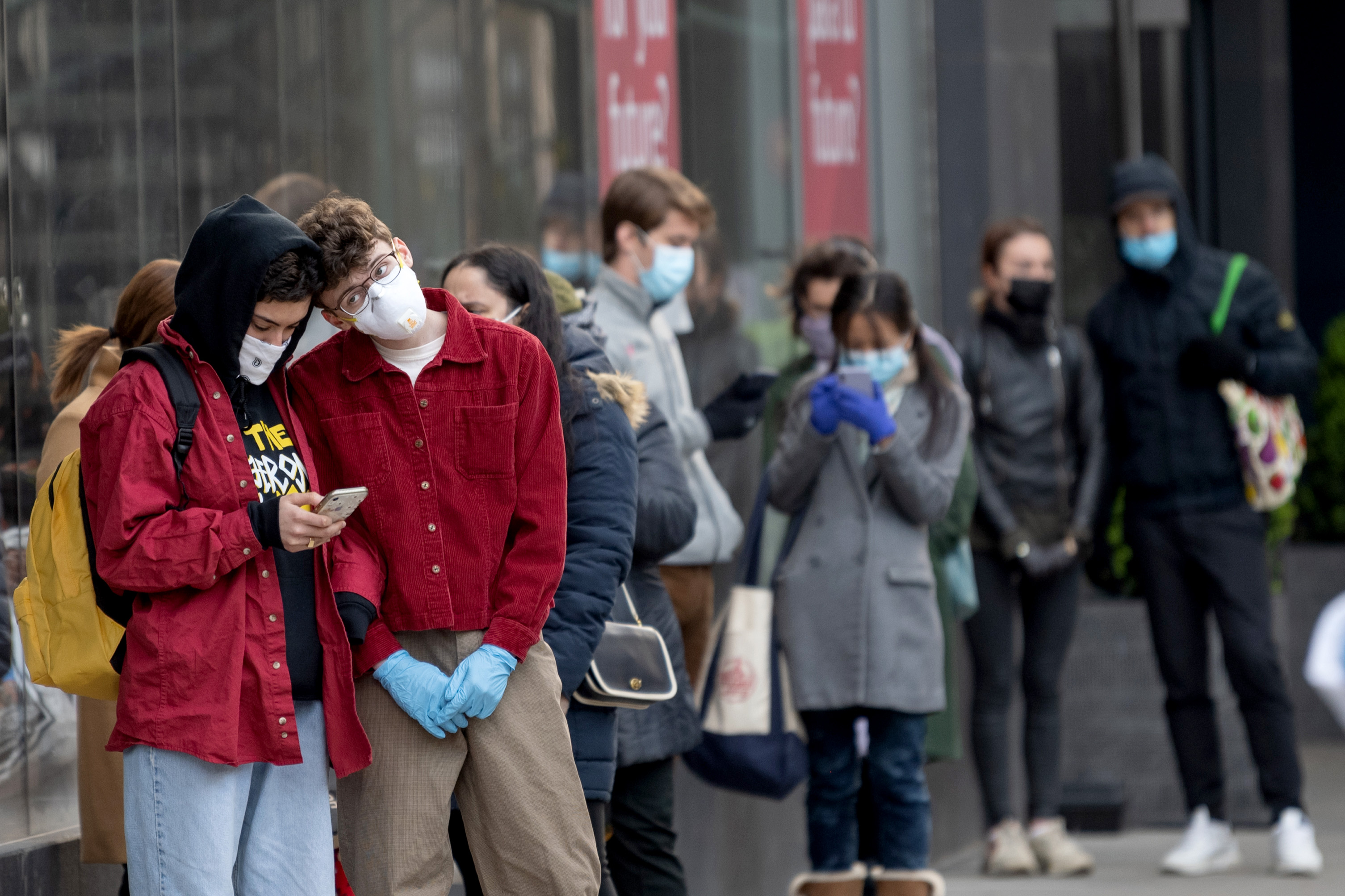 Shoppers stand in line outside a supermarket line amid the coronavirus pandemic on April 16, 2020 in New York City.