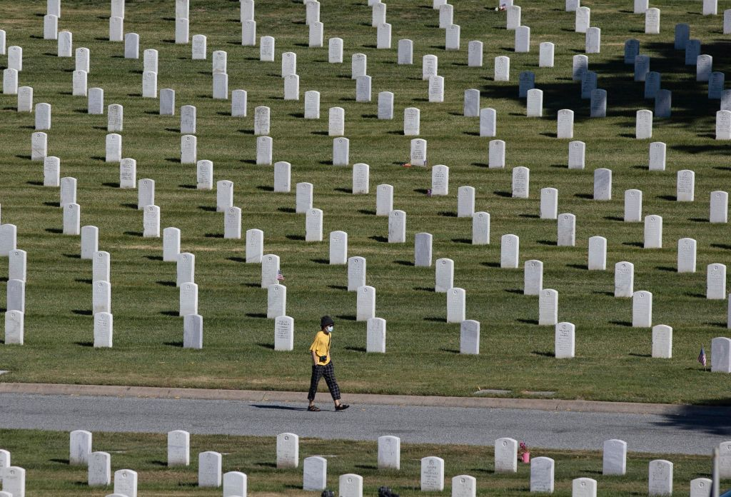 A man walks amongst the graves on Memorial Day at the Golden Gate National Cemetery in San Bruno, Calif., amid the coronavirus outbreak on May 25, 2020.
