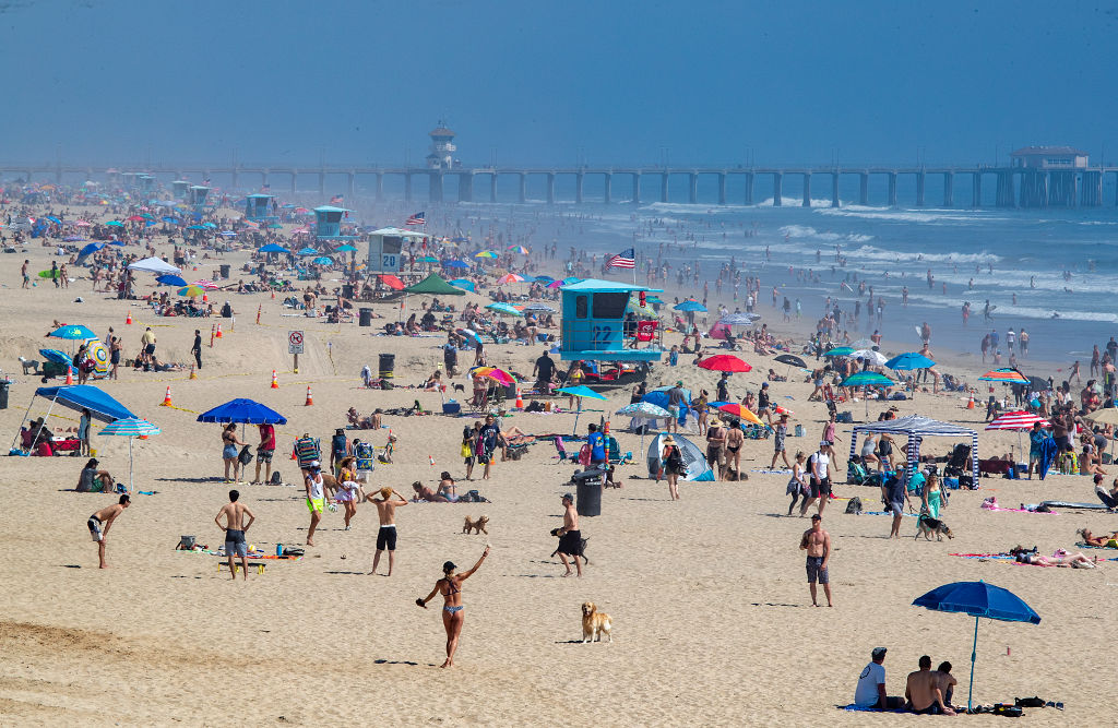 Thousands of beach-goers enjoy a warm, sunny day at the beach amid state-mandated stay-at-home and social distancing mandate to stave off the coronavirus pandemic in Huntington Beach, CA, on April 25, 2020.