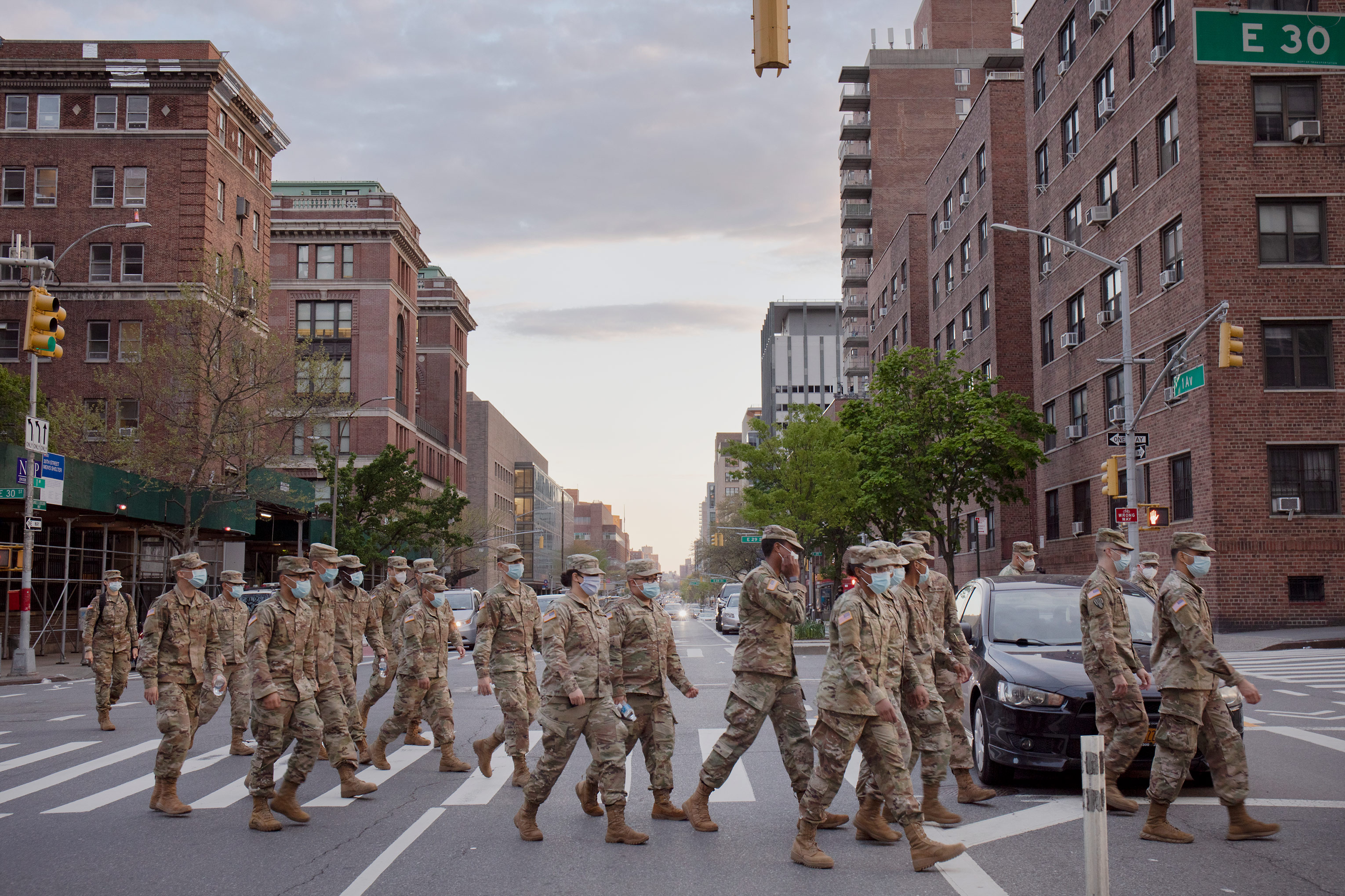 A group of U.S. service members leave a medical examiner's disaster morgue on May 2 to head to their hotels for the night.