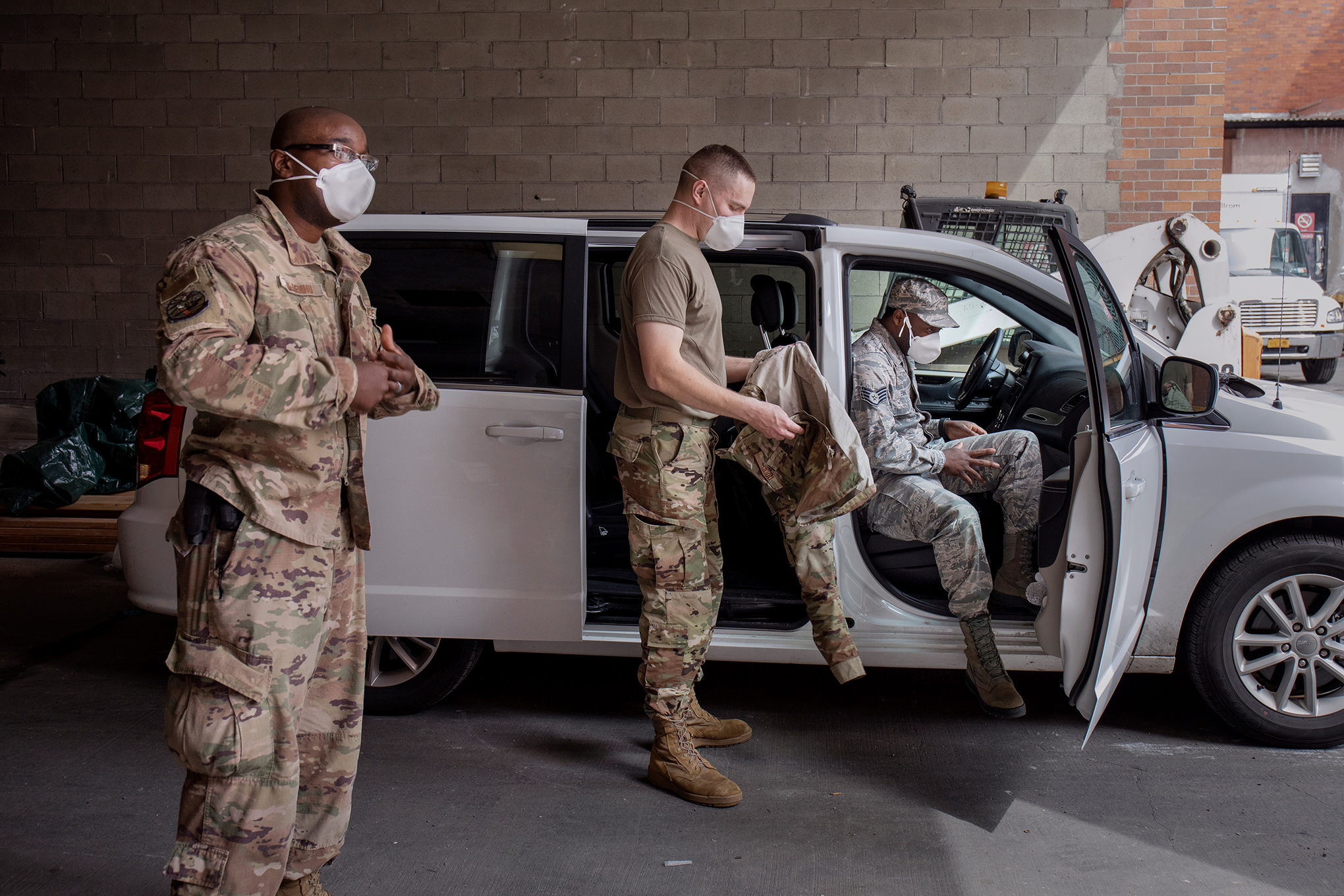 Senior Airman Steve Ollennu, at left, leads a National Guard team of three. A May 2 removal call took them to Lincoln Medical Center in the Bronx, the hospital where Ollennu was born.