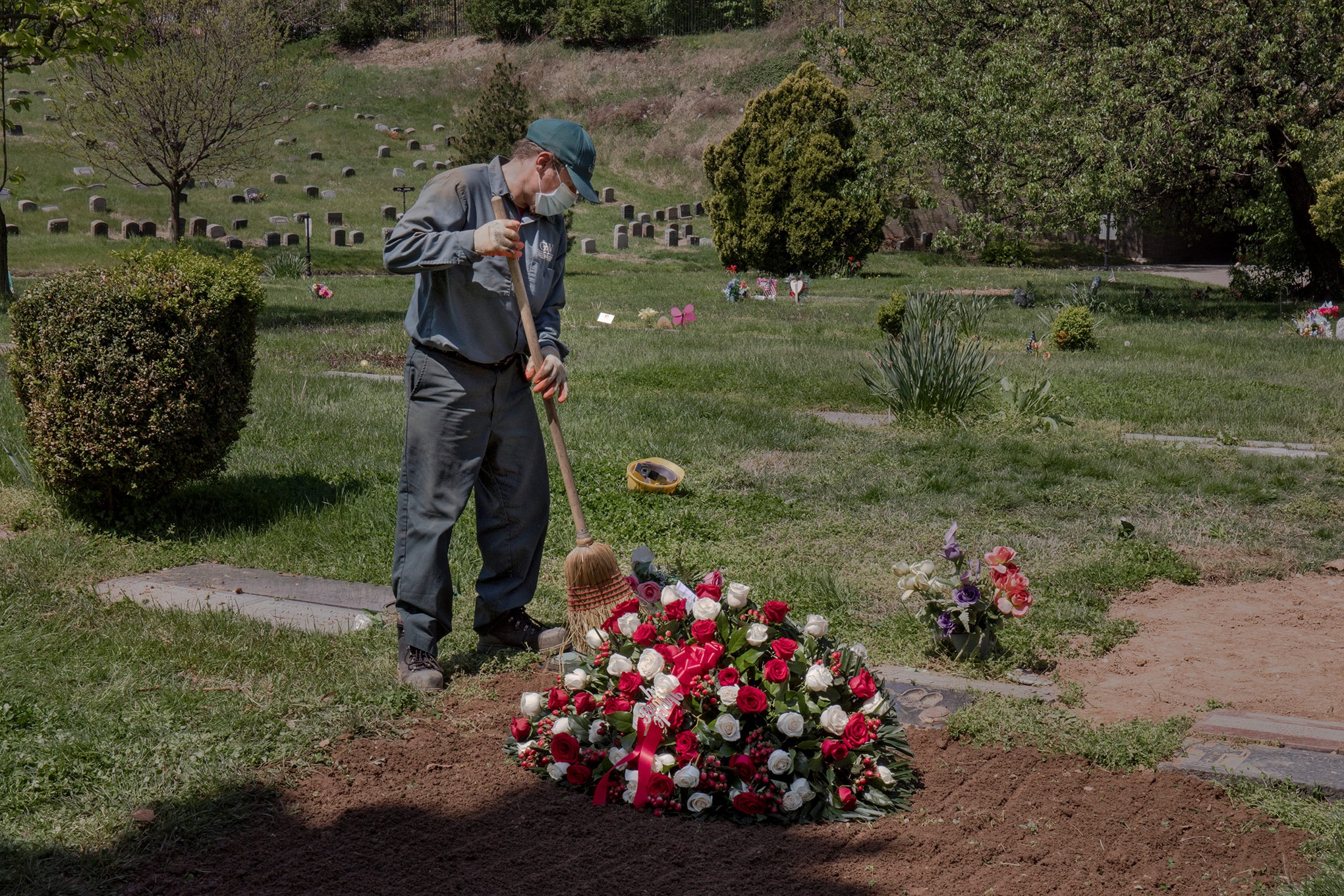 Social distancing regulations have made funerals lonely and rare. On May 4, Janusz Karkos tends the grave of a COVID-19 victim at Brooklyn's Green-Wood Cemetery.