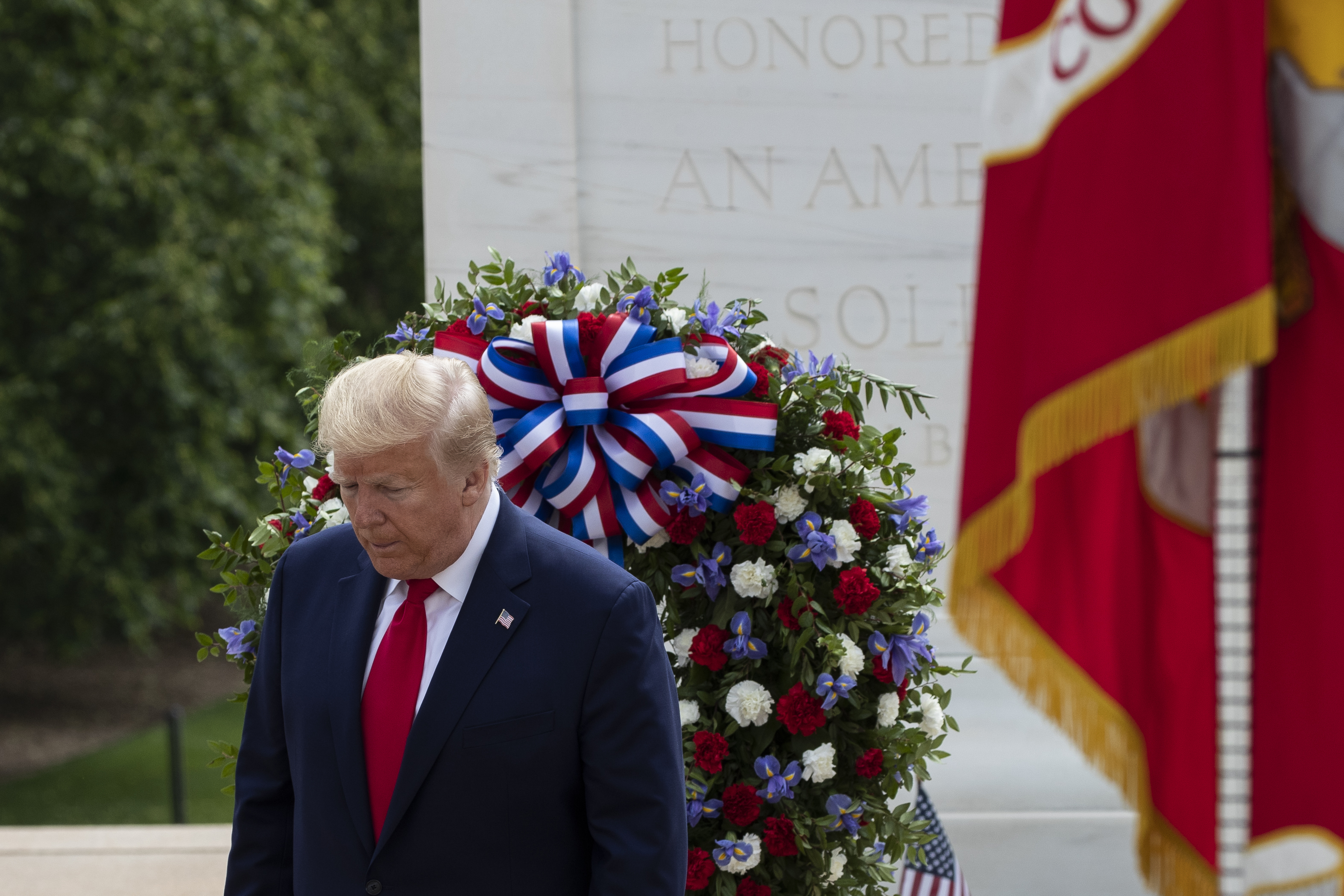 President Donald Trump turns after placing a wreath at the Tomb of the Unknown Soldier in Arlington National Cemetery, in honor of Memorial Day, May 25, 2020, in Arlington, Va.