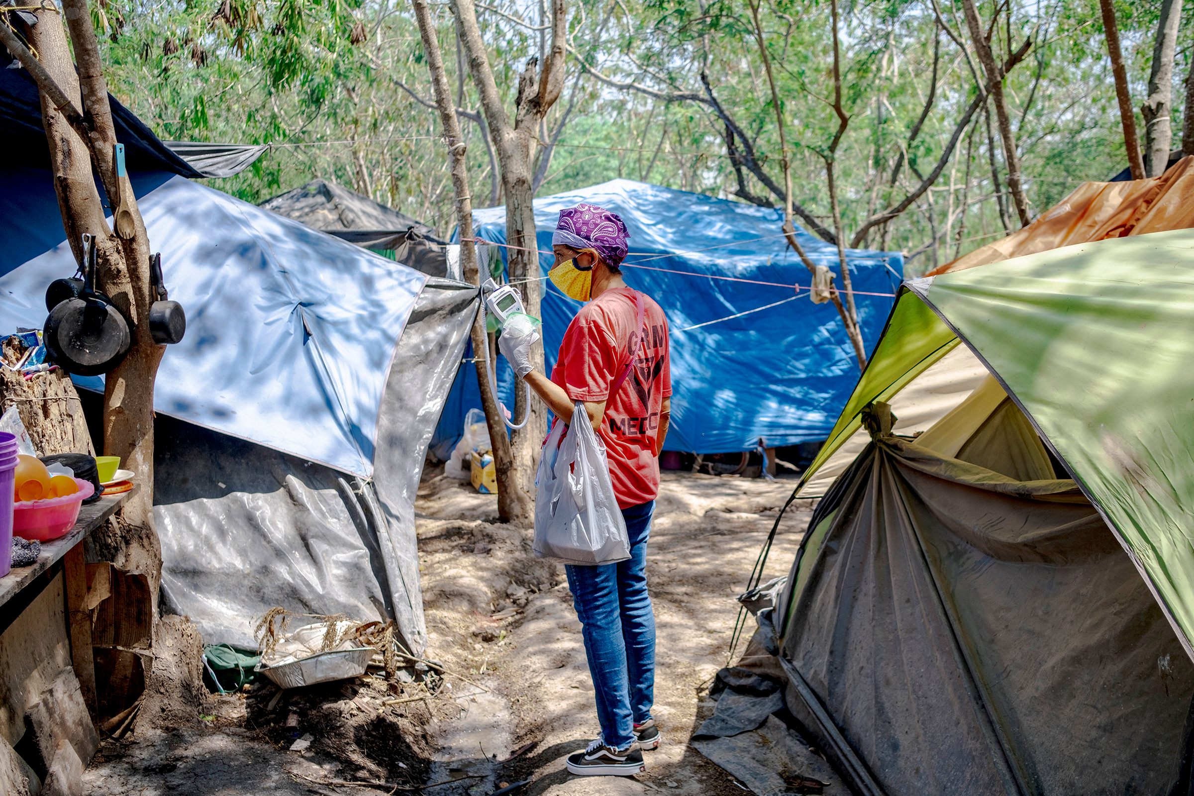 A member of the Global Responses Management medical team in the Matamoros camp on April 24.  Social distancing and quarantine in refugee situations is nearly impossible,  says Helen Perry, an acute care nurse practitioner and executive director of GRM.