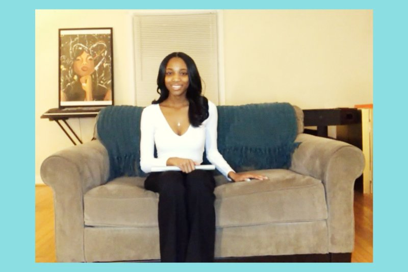 Kamryn will graduate in front of a parking lot of cars in early June; she's pictured here in her home, via Zoom