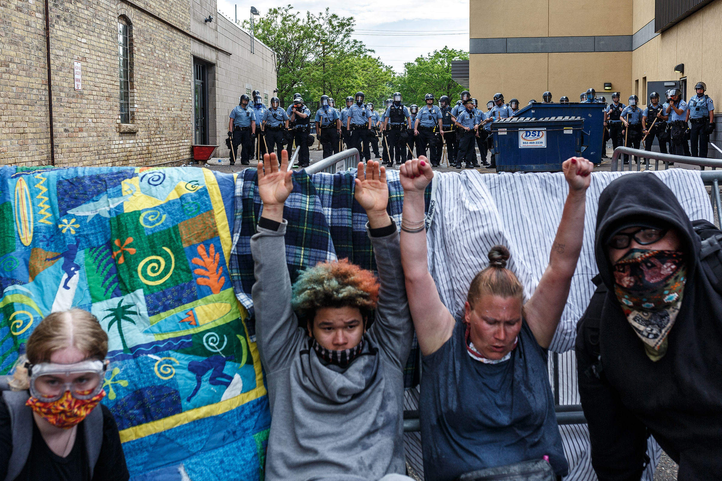 Protesters hold their hands up as they cry from from tear gas during a demonstration calling for justice for George Floyd on May 27, two days after his death.