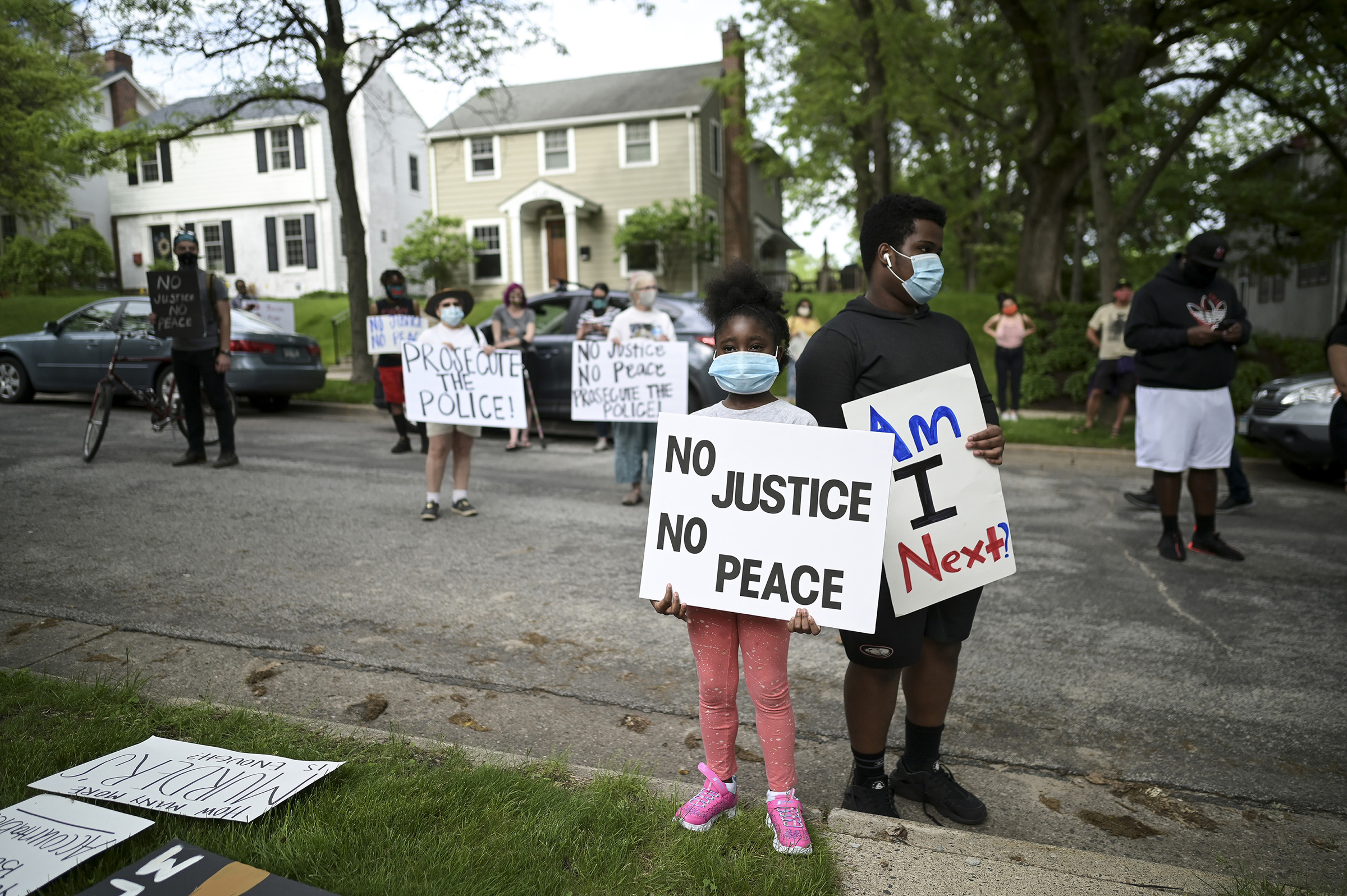 Deshawn Williams, 15, and his sister, Sarah Newell, 7, protest outside Hennepin County Attorney Mike Freeman's home in Minneapolis on May 27.