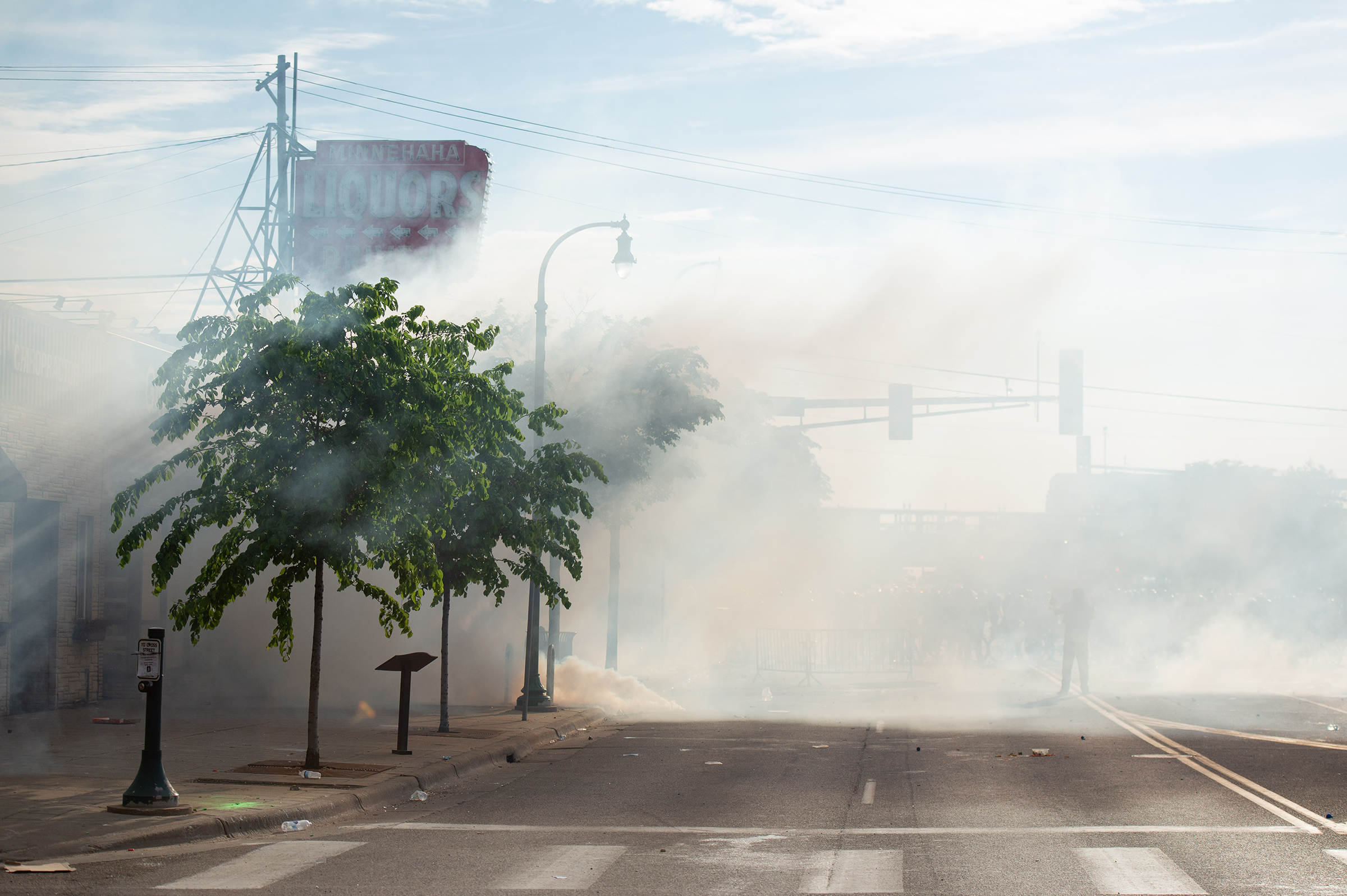 Clouds of tear gas linger in the air over Lake Street during the second day of protests in Minneapolis on May 27.