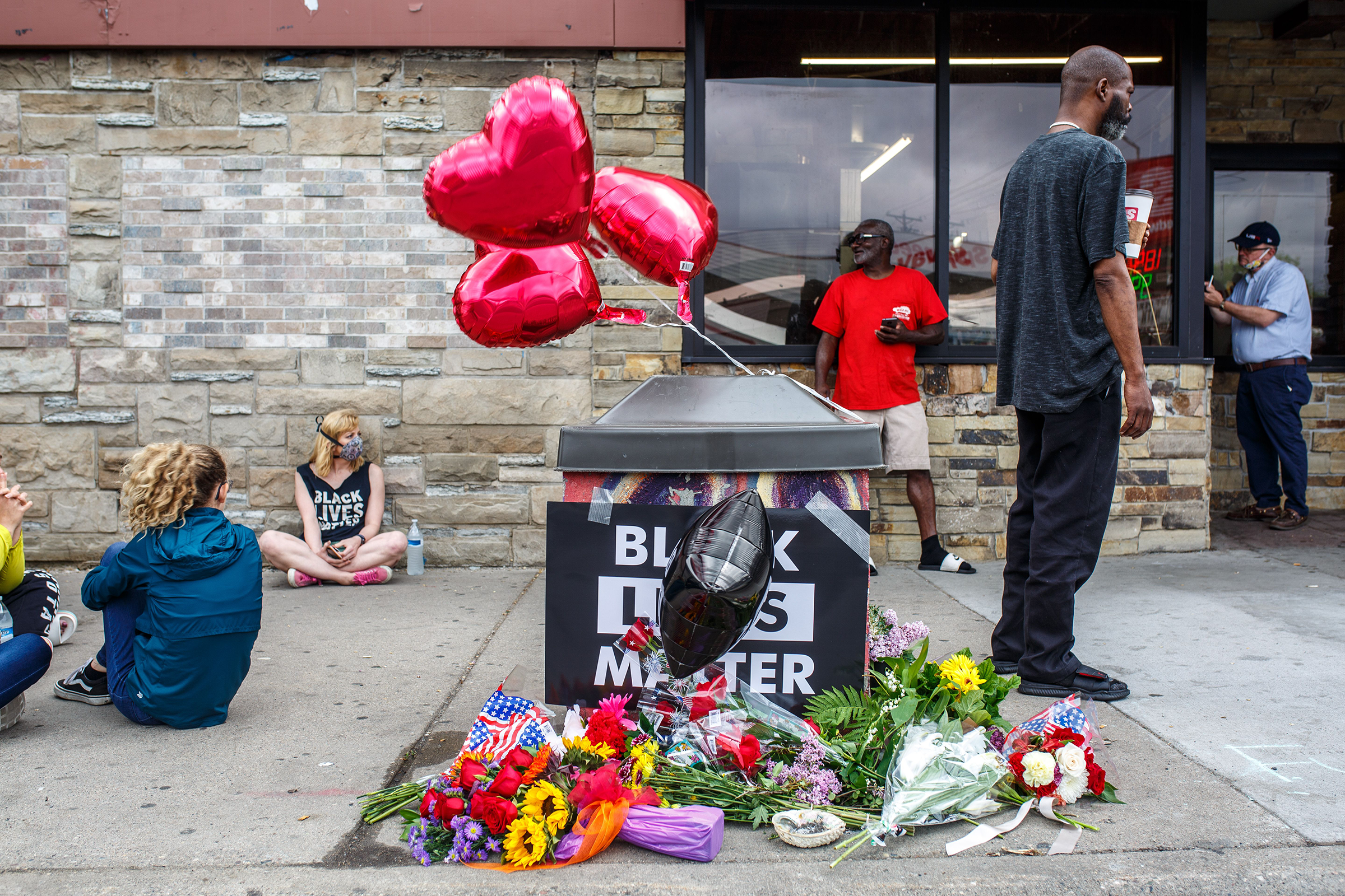 A memorial left for George Floyd, at the scene where an officer pinned him down a day earlier, in Minneapolis on May 26.
