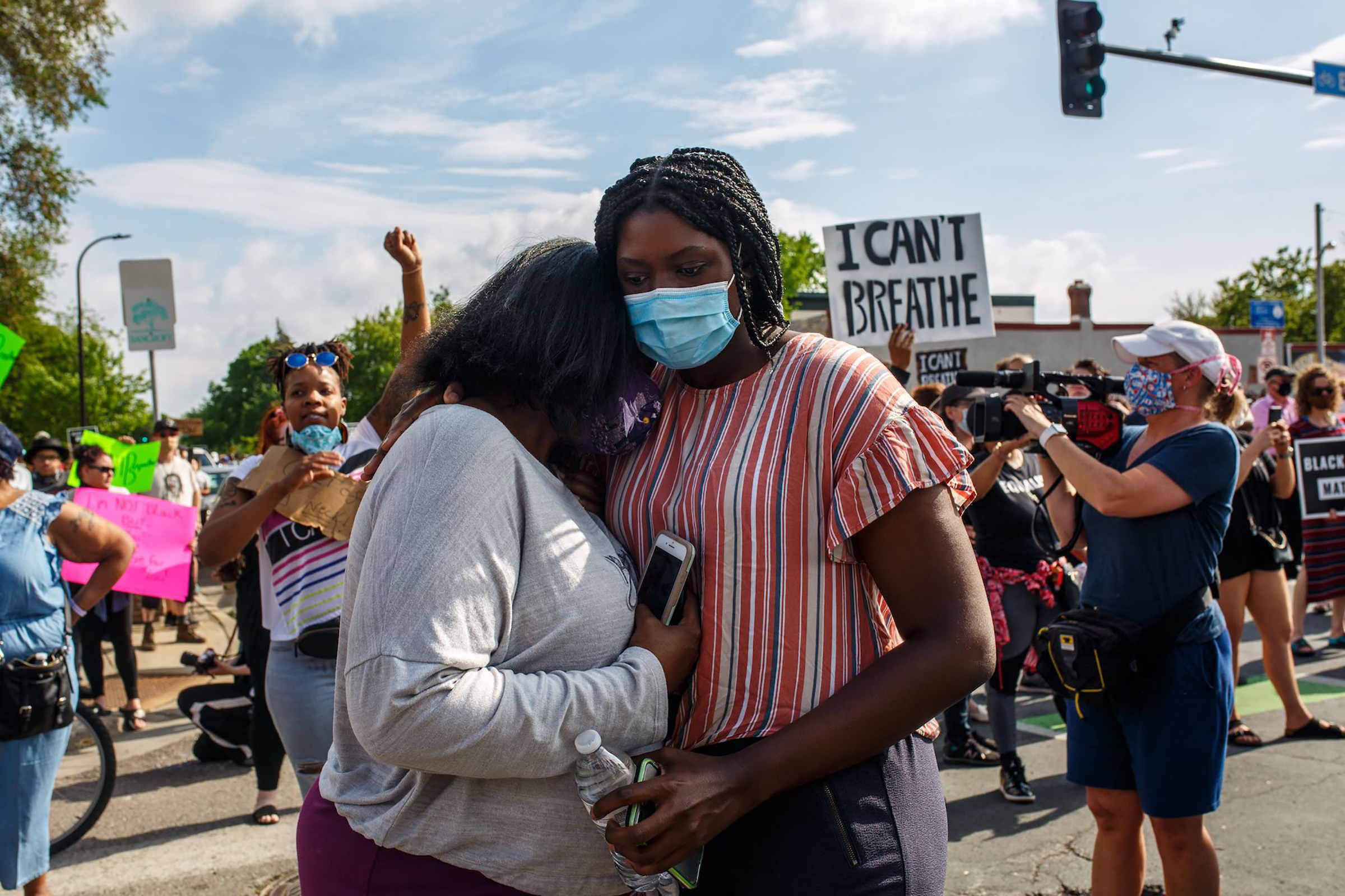 Two women embrace at a protest over the killing of George Floyd in Minneapolis on May 26, 2020.