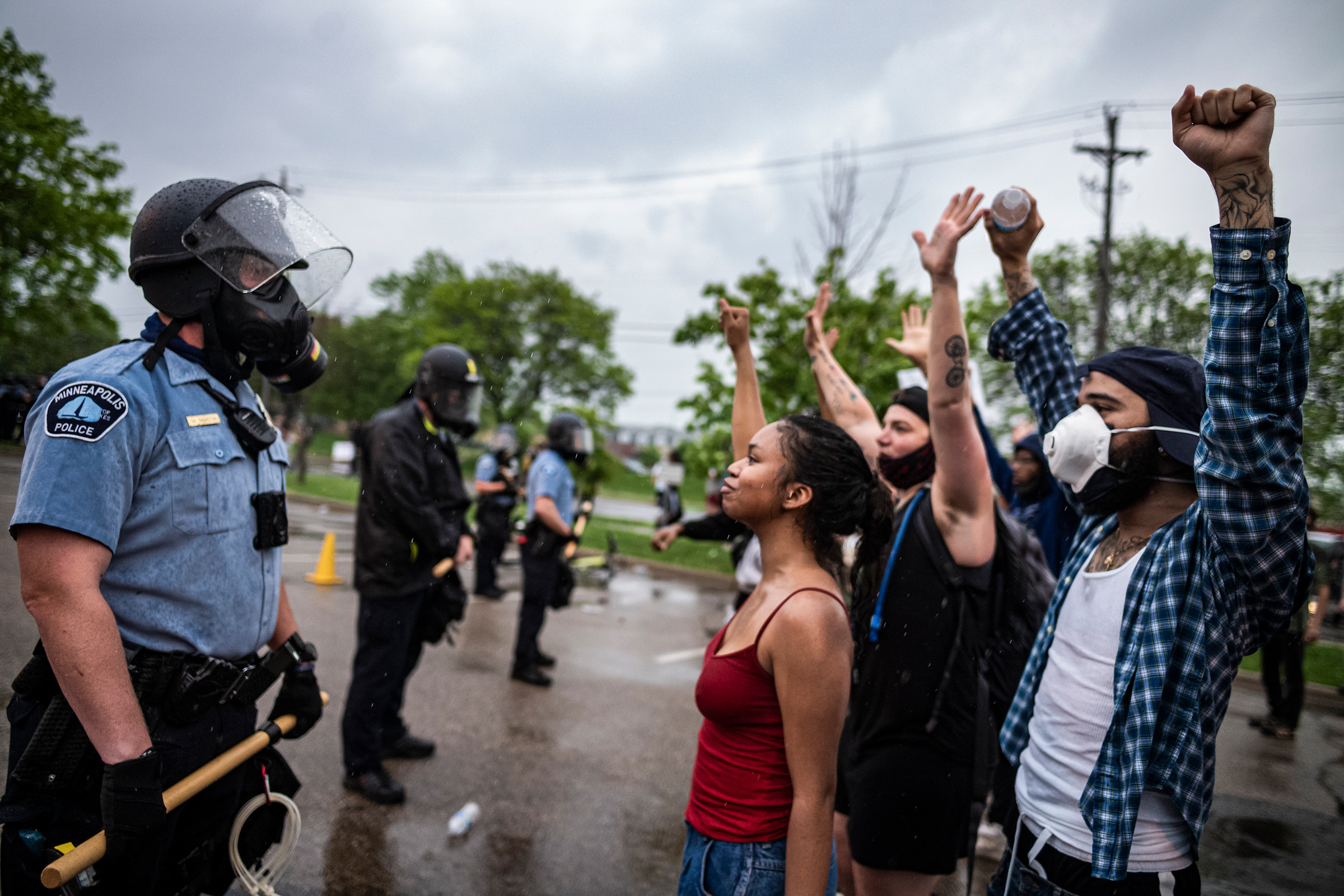 Protesters face off with police in Minneapolis on May 26 after video footage from a day earlier surfaced showing a white officer kneeling on the neck of a handcuffed black man—identified as George Floyd by an attorney for his family—despite saying he could not breathe. Floyd was later pronounced dead at Hennepin County Medical Center. Four officers involved in the arrest were fired.