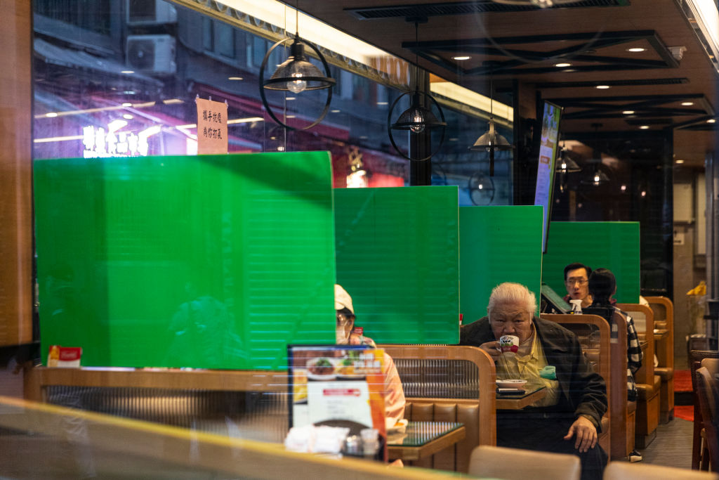 Plastic barriers enforcing social distancing measure seen in a restaurant during the coronavirus pandemic in Hong Kong on April 3, 2020.