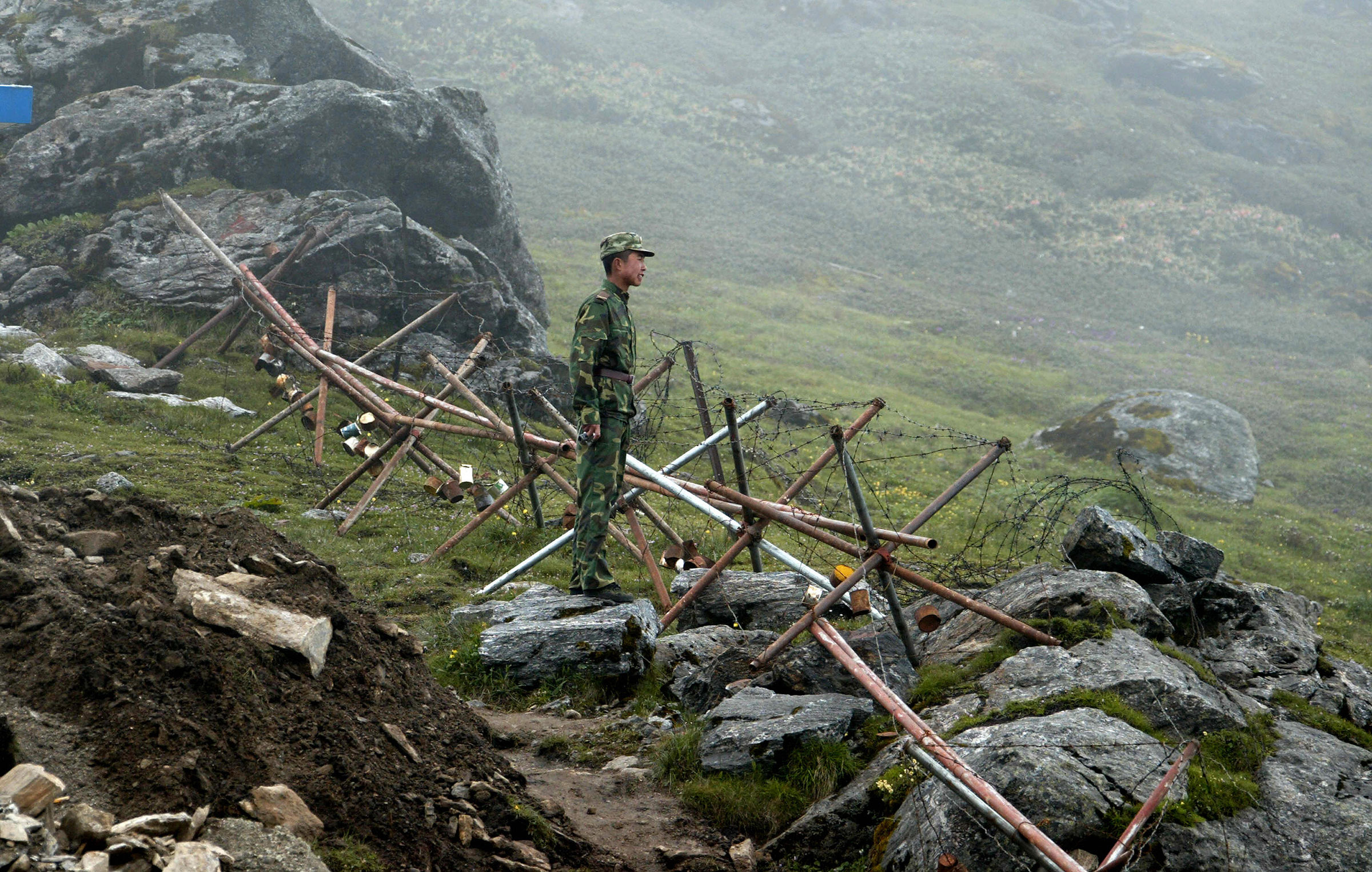 A Chinese soldier stands guard on the Chinese side of the ancient Nathu La border crossing between India and China on July 10, 2008.