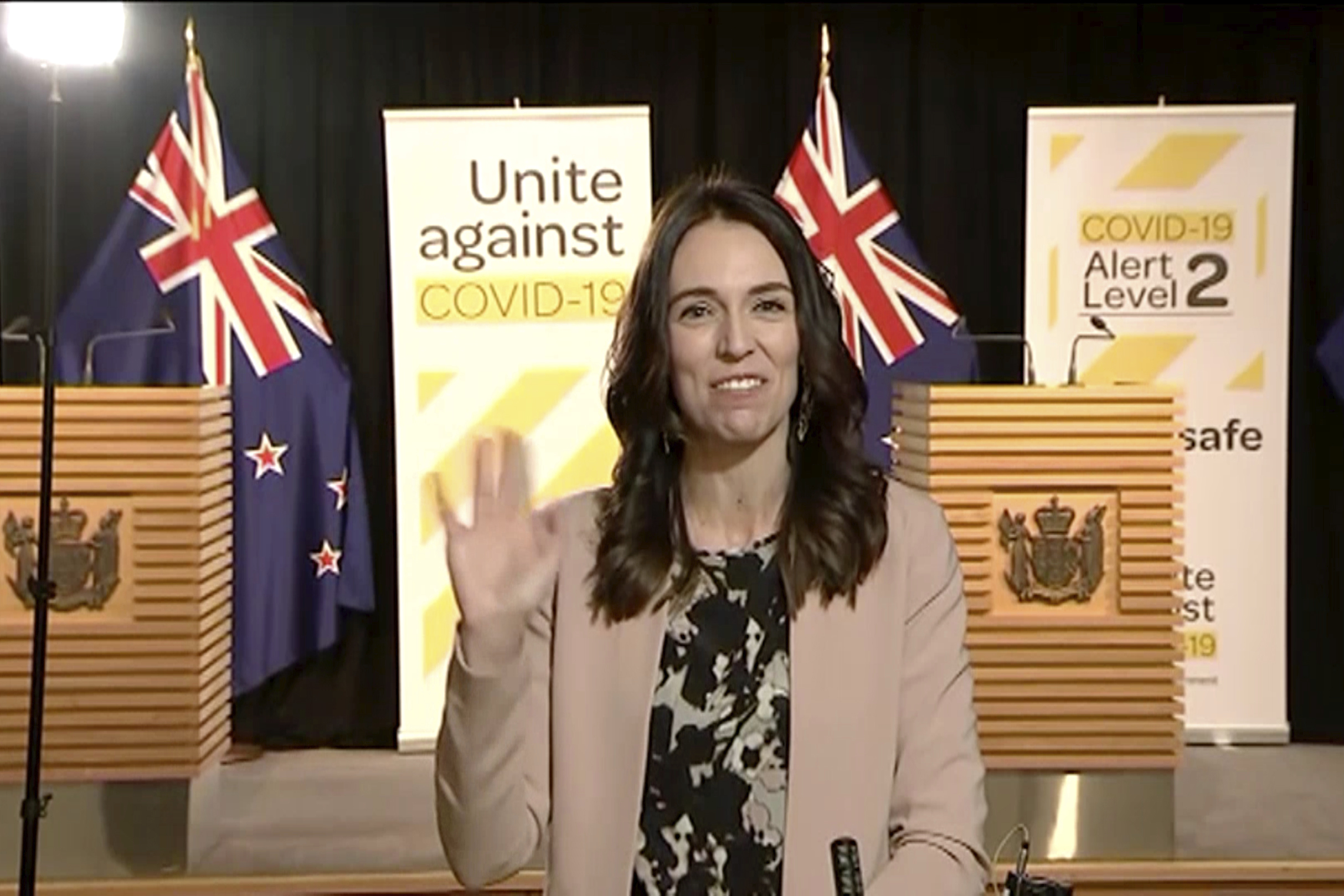 In this image made from video, New Zealand Prime Minister Jacinda Ardern waves to continue to speak when shaking stopped after an earthquake during a live television interview in Wellington, New Zealand, Monday morning, May 25, 2020. The quake struck in the ocean about 100 kilometers (62 miles) northeast of Wellington, according to the U.S. Geological Survey. New Zealand sits on the Pacific Ring of Fire and is sometimes called the Shaky Isles for its frequent quakes.