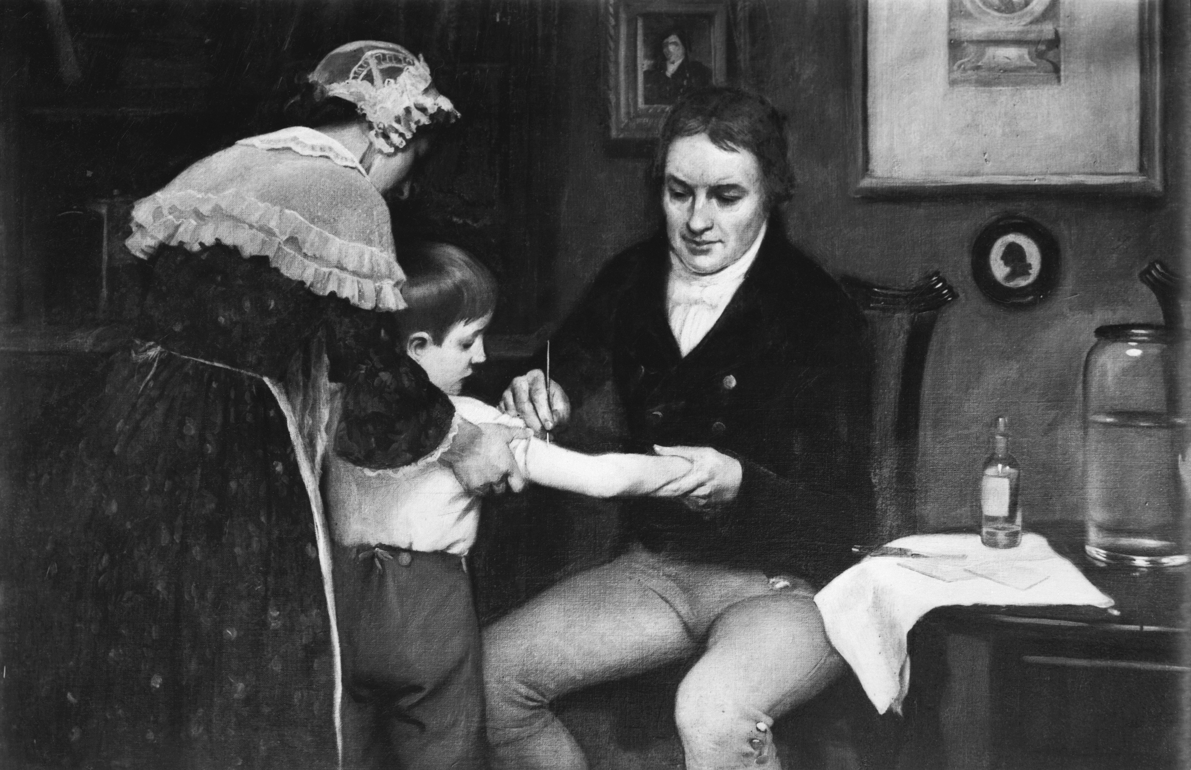 Dr. Edward Jenner (1749-1823) performing his first vaccination on James Phipps on May 14, 1796. Painting by E. Board in the Welcome Museum, London. Undated painting.