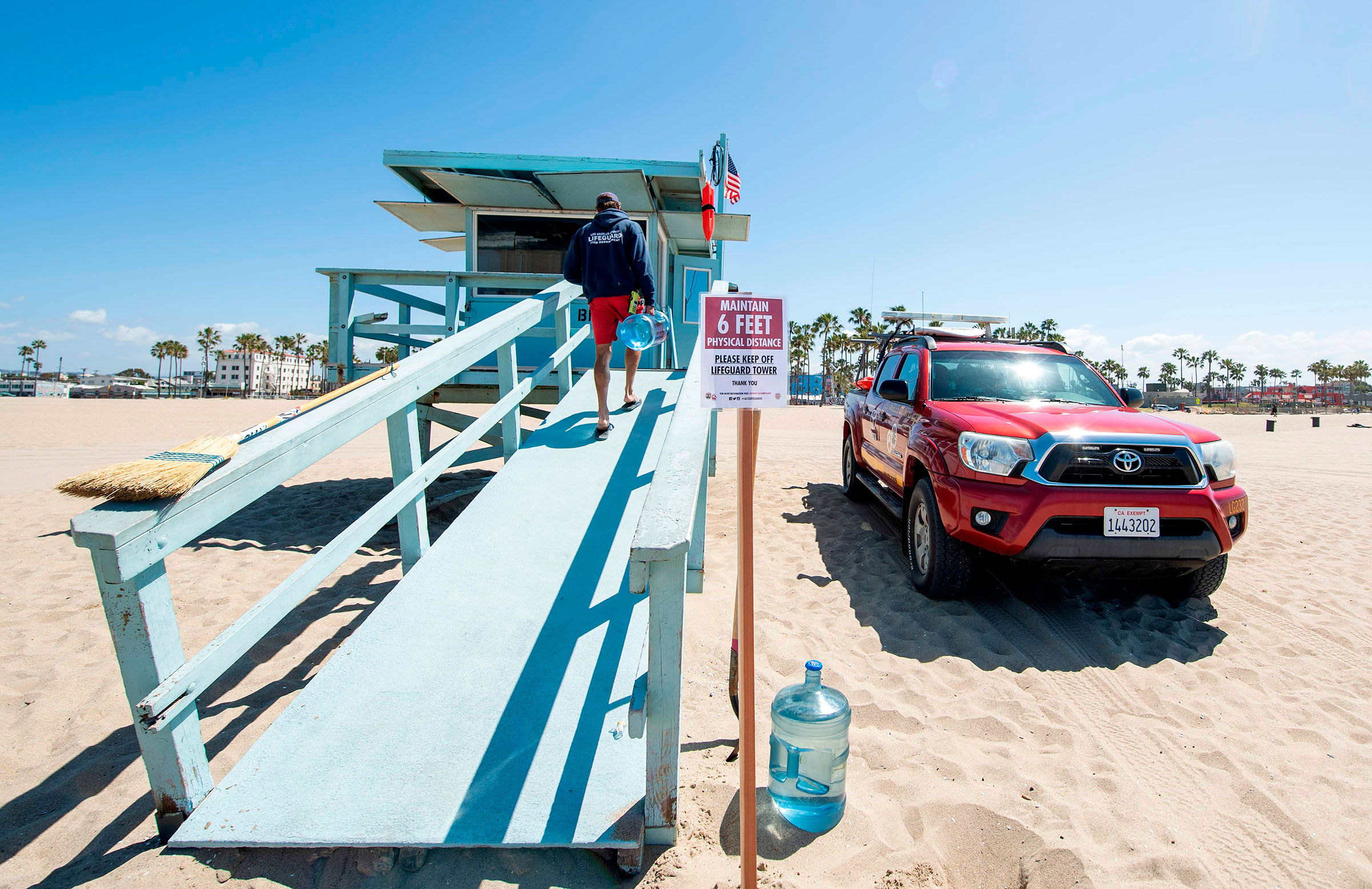 A lifeguard opens his tower in Venice Beach on the first day Los Angeles County allowed beaches to reopen after a six-week closure implemented to stop the spread of the coronavirus on May 13, 2020.