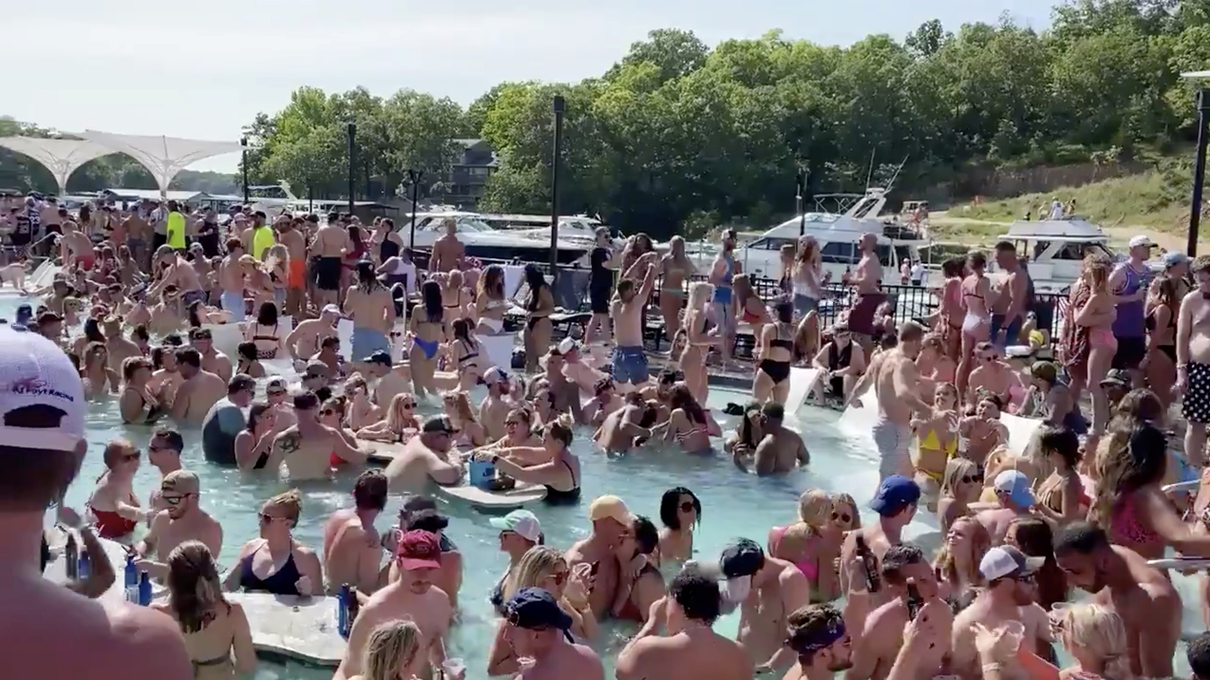 Revelers celebrate Memorial Day weekend at Osage Beach of the Lake of the Ozarks, Missouri, U.S., May 23 in this screen grab taken from social media video