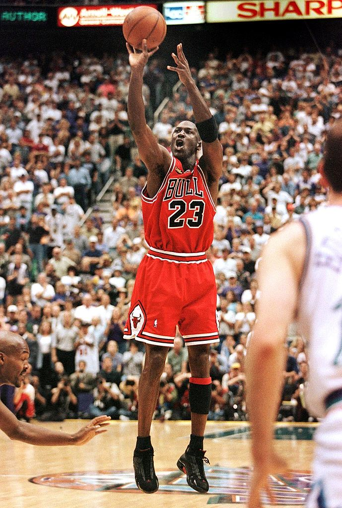 In this June 14, 1998 file photo, with 5.2 seconds left in the game, Michael Jordan of the Chicago Bulls aims and shoots the game-winning jump-shot during game six of the NBA Finals with the Utah Jazz at the Delta Center in Salt Lake City, UT. The Bulls won the game 87-86 to win their sixth NBA championship.