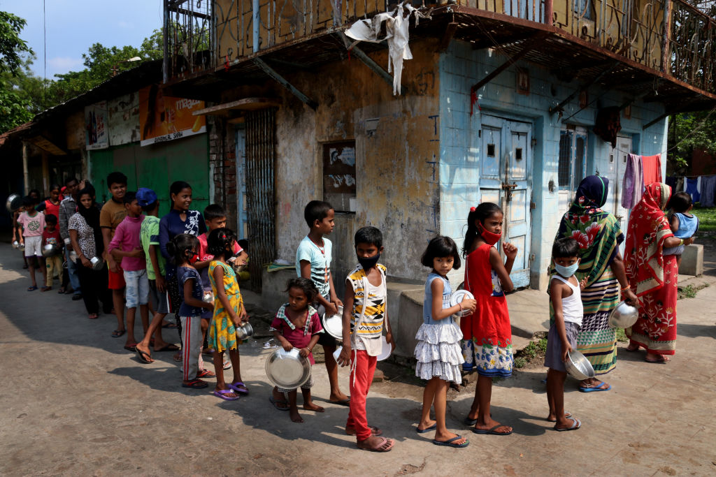 People line up to receive free food distributed by a Hindu group during a government-imposed nationwide lockdown as a preventive measure against the COVID-19 coronavirus, in Kolkata, India on April 25, 2020.
