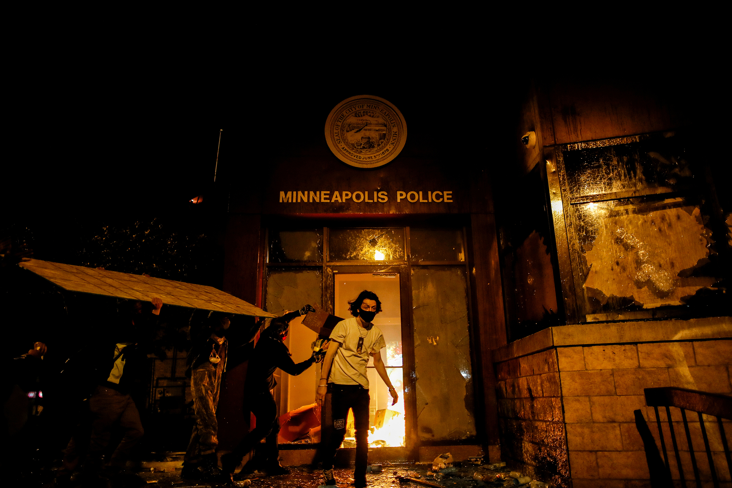 Protesters set fire to the entrance of a police precinct in Minneapolis on May 28 as demonstrations continue in the wake of George Floyd's death. Three days earlier, a white police officer was caught on a bystander's video pressing his knee into the neck of Floyd, a black man, who later died at a hospital.