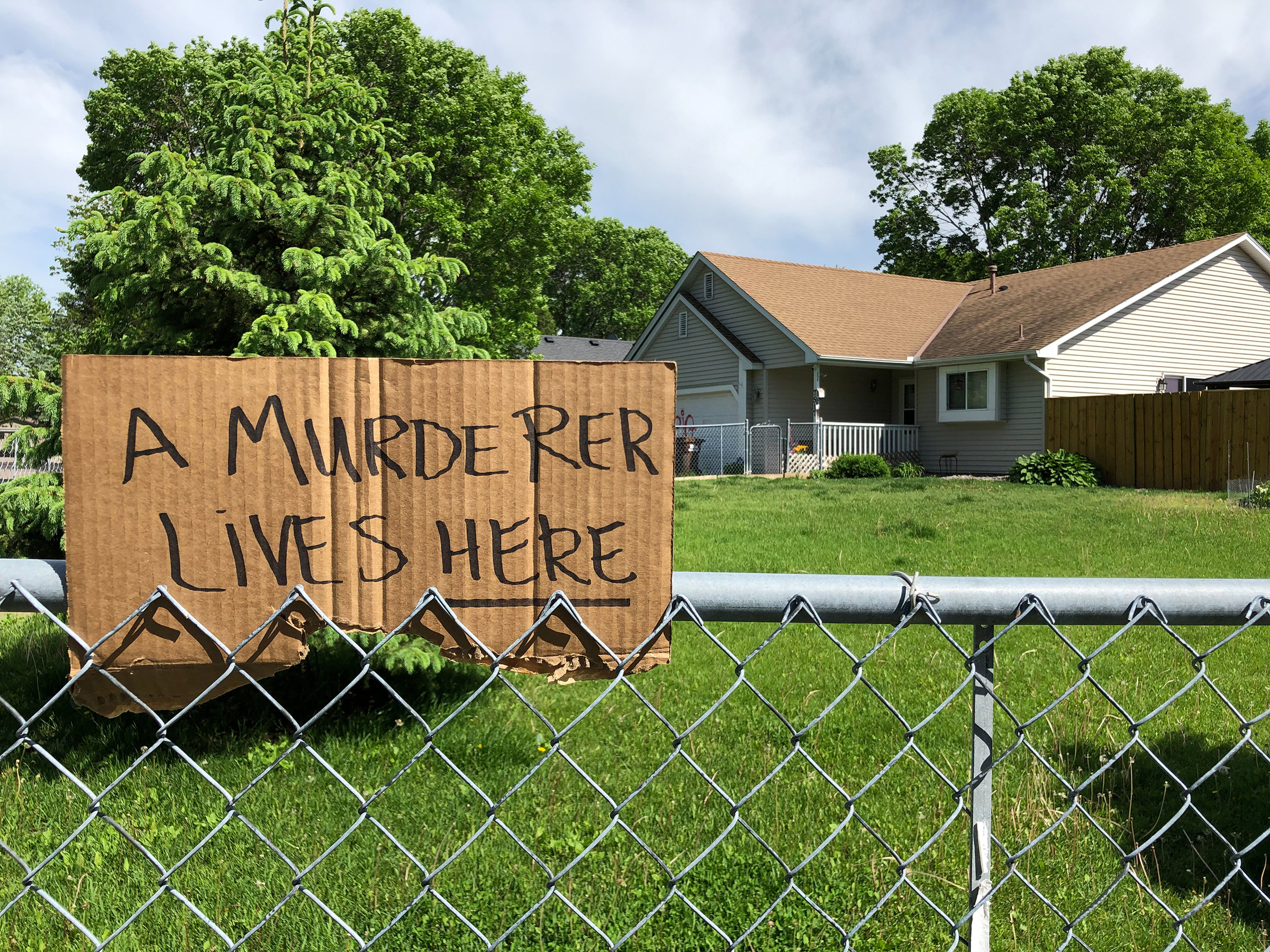 A sign outside of police officer Derek Chauvin's house in Oakdale, Minn., on May 28.