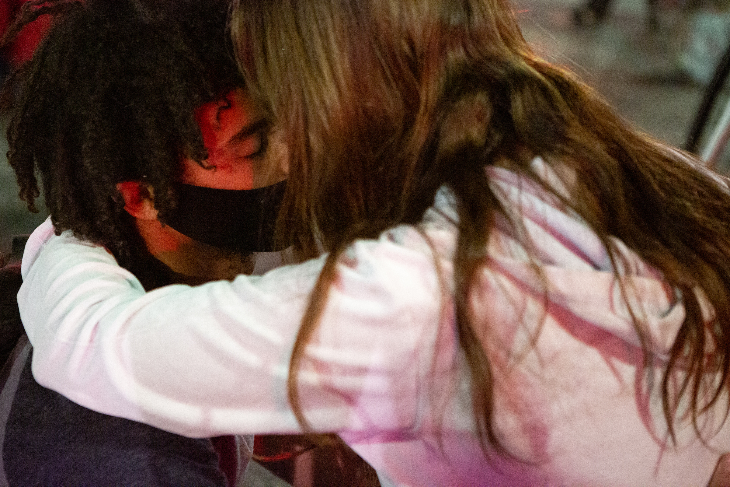 Two protesters embrace while occupying the intersection of South Hill Street and W Second Street after a Black Lives Matter protest in Los Angeles on May 27.
