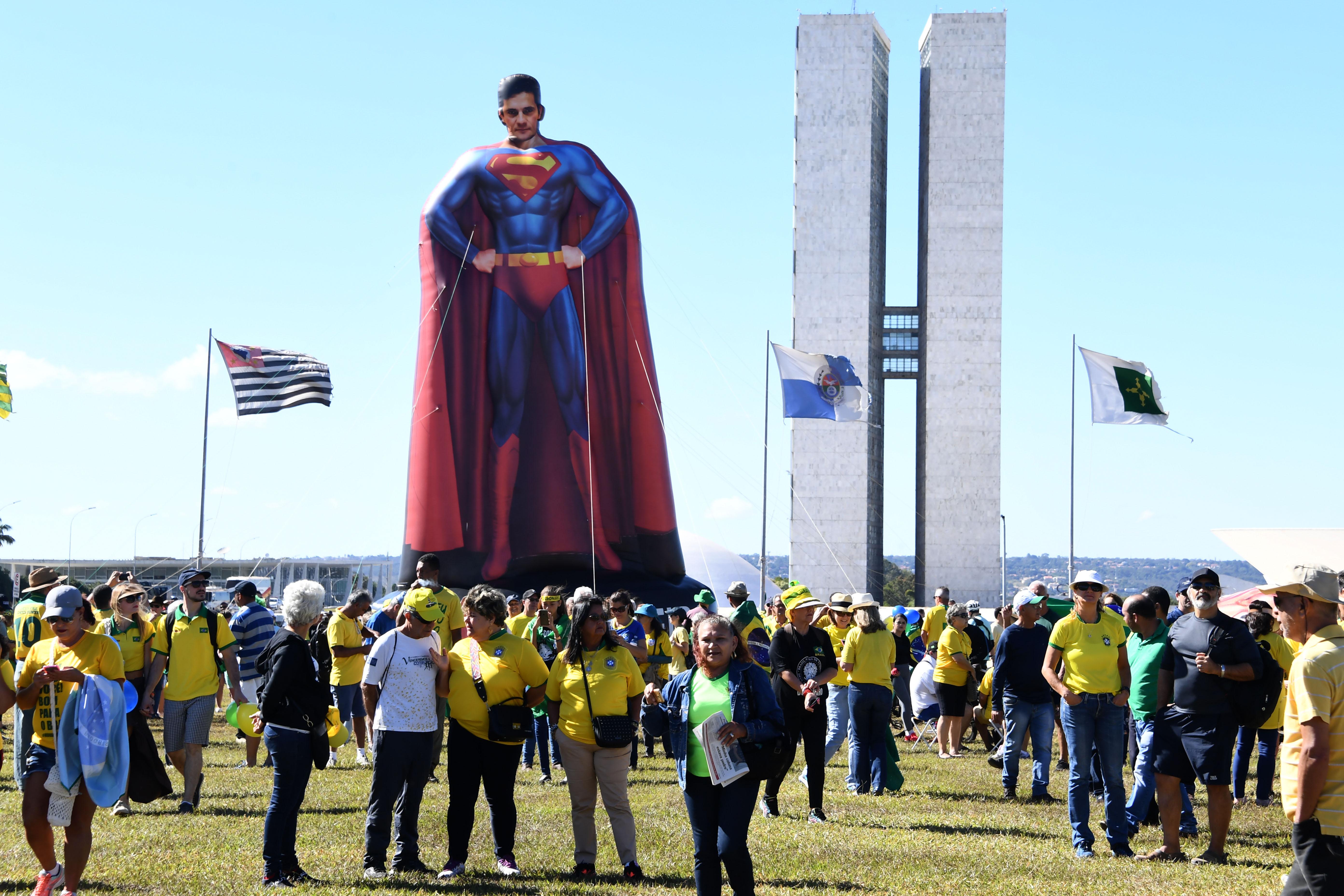 People demonstrate in support of Brazilian president Jair Bolsonaro and Justice Minister Sergio Moro in Brasilia, on June 30, 2019.