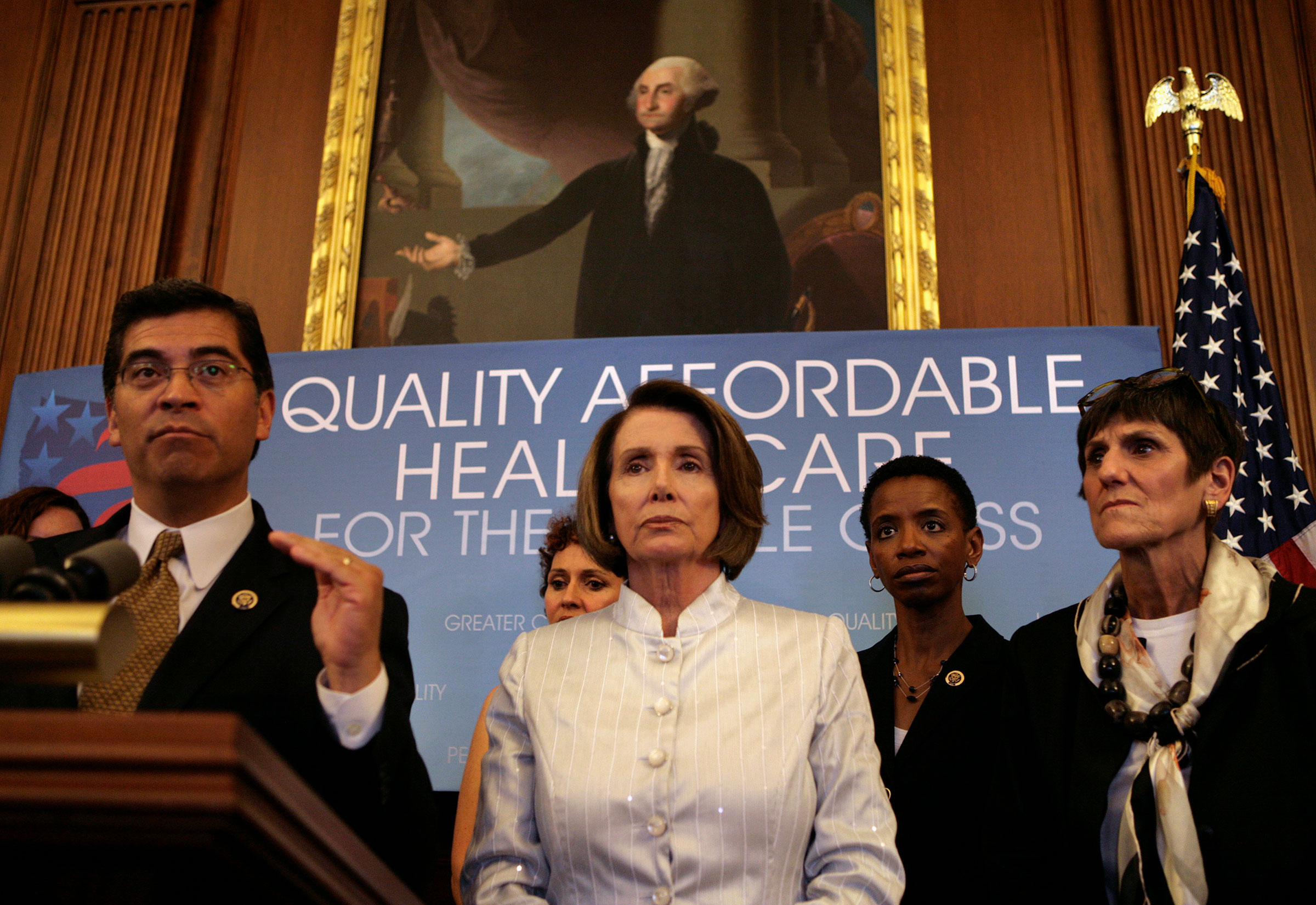 Rep. Xavier Becerra speaks next to Speaker of the House Nancy Pelosi during a news conference on America's Affordable Health Choices Act on Capitol Hill on July 22, 2009.