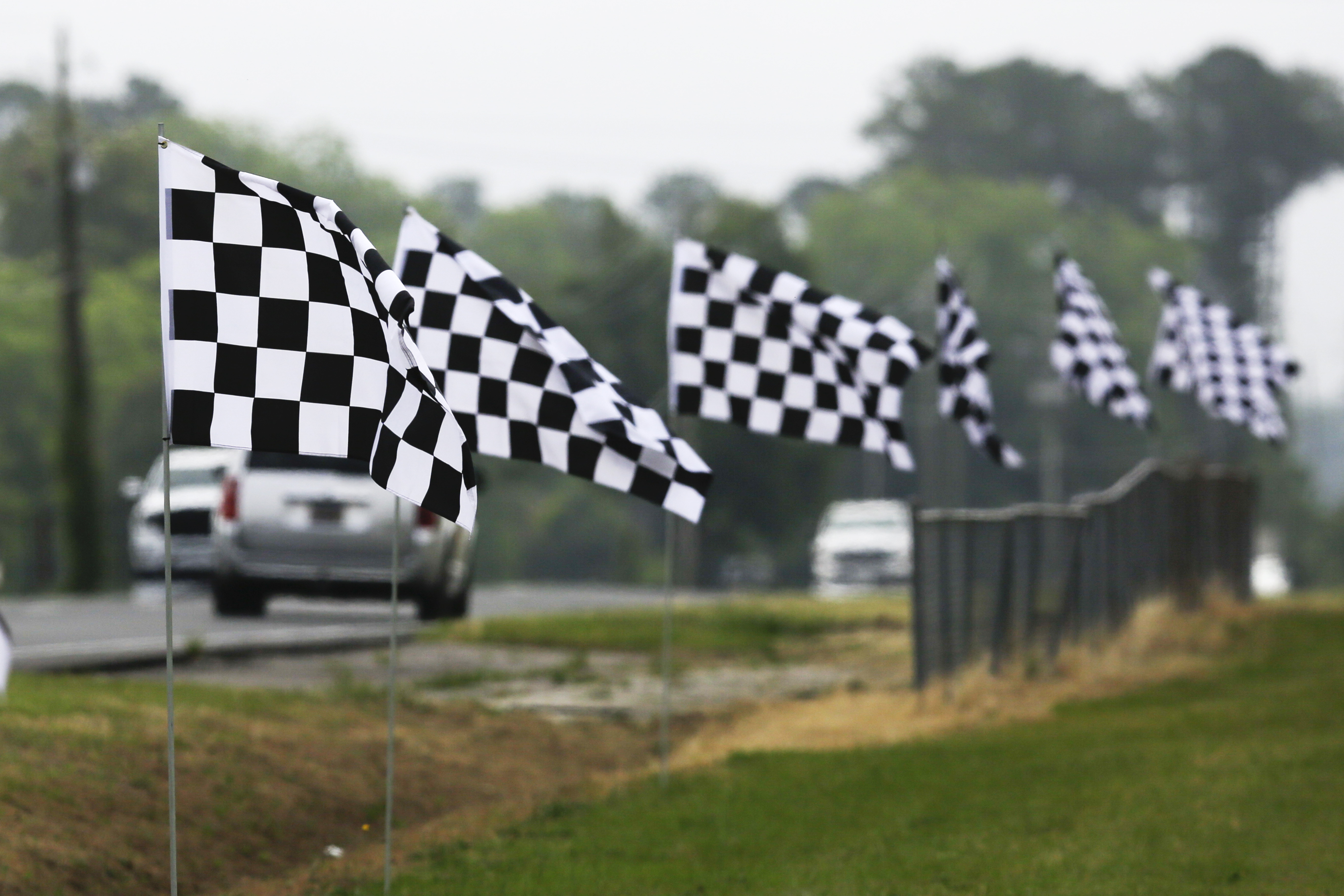 Checkered flags line a street outside Darlington Raceway on May 17, 2020, in Darlington, S.C.