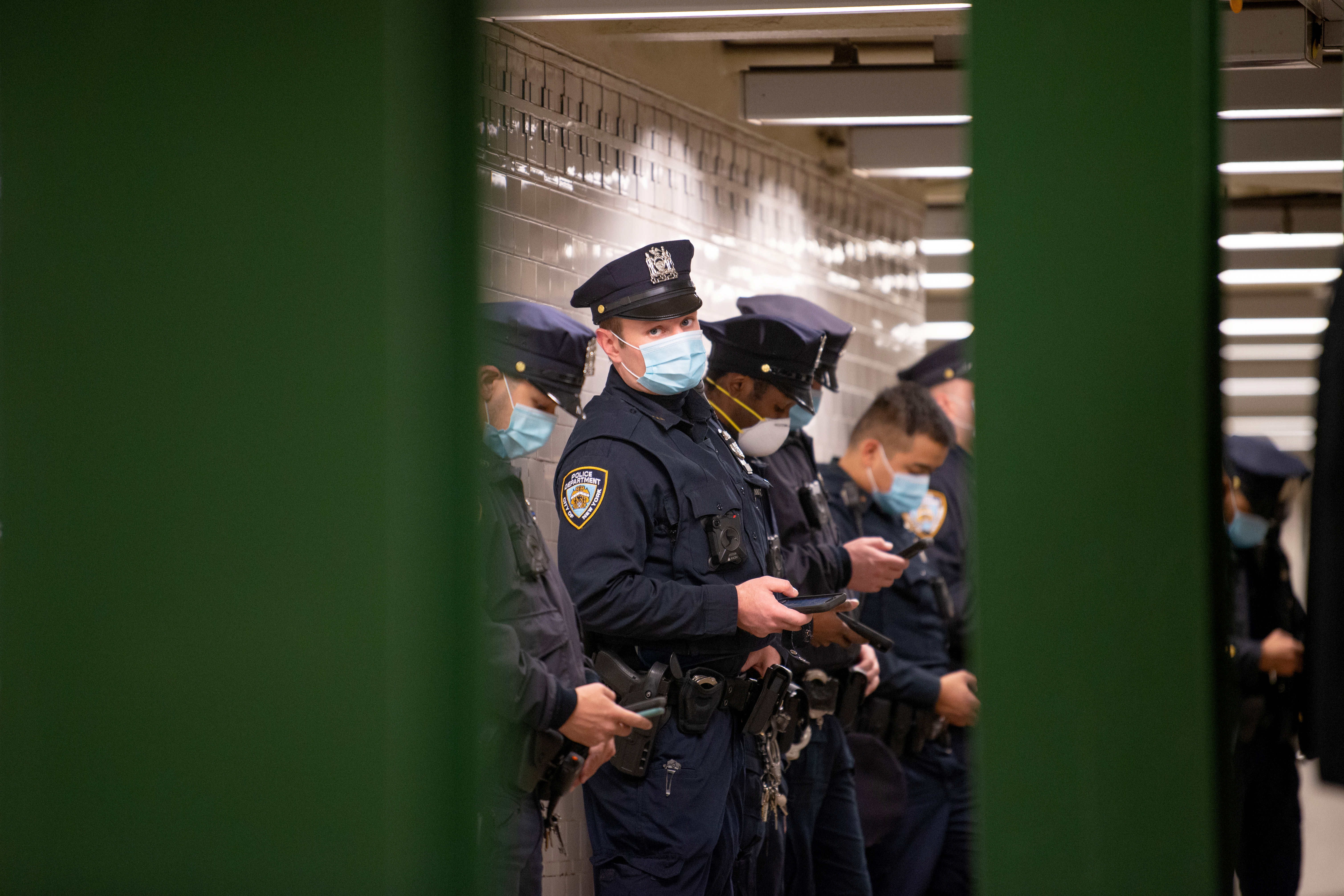 An NYPD officer wearing a mask looks at the camera during a briefing in the Union Square subway station May 6, 2020 in New York City.