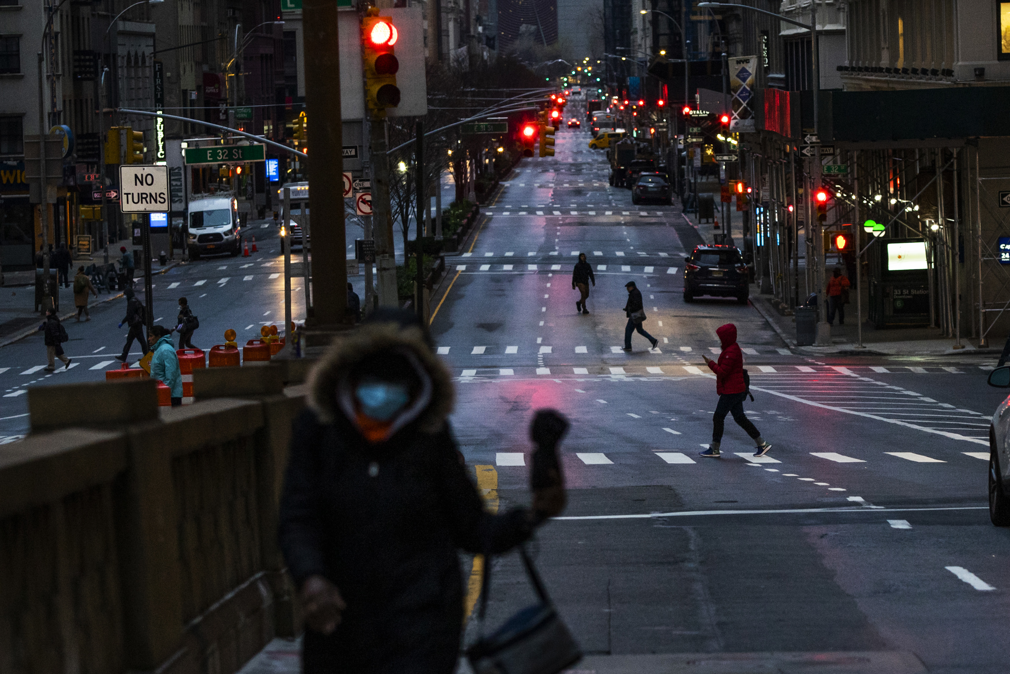 People cross Park Ave. after it was announced that some streets will be shut as lockdown continues in response to the COVID-19 outbreak on March 27, 2020 in New York City.
