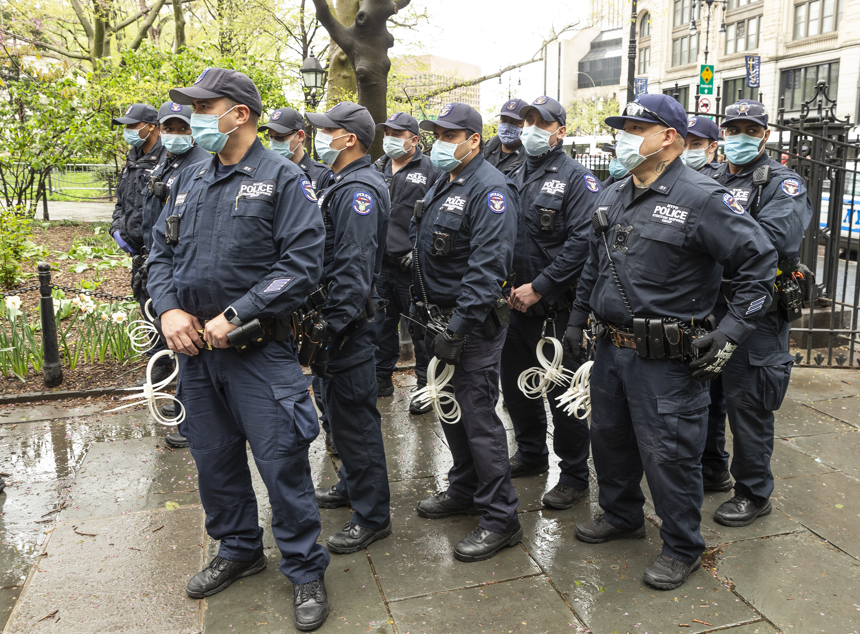 Police officers watch as activists hold small Make America Great Again (MAGA) rally in City Hall Park advocating for reopening New York state regardless of COVID-19 pandemic.