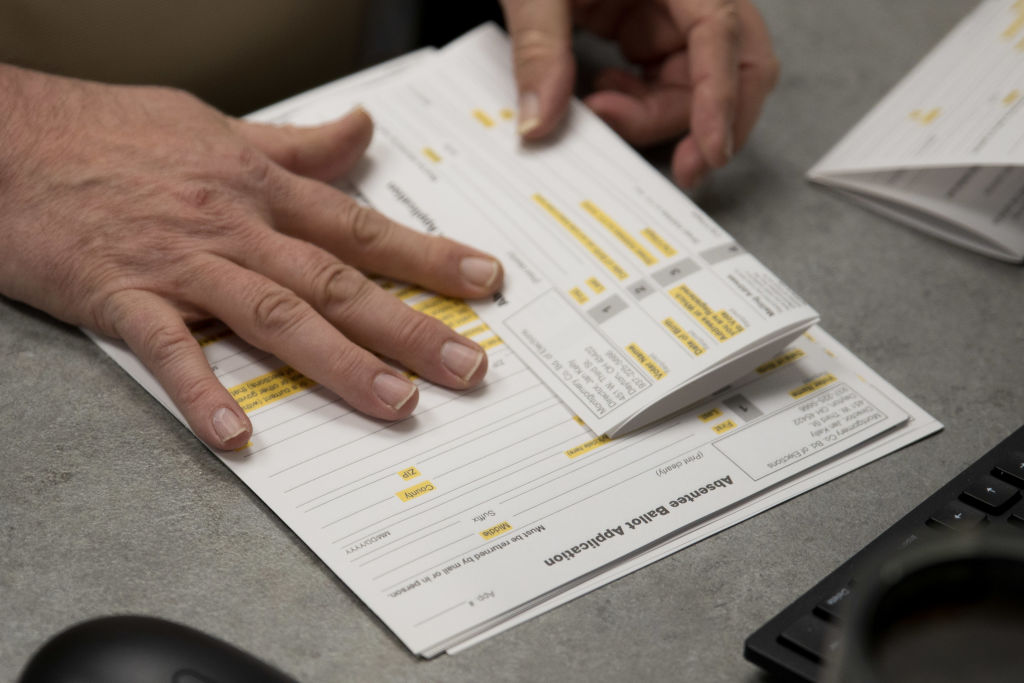 A county election worker prepares absentee ballots in Dayton, Ohio on March 17, 2020.