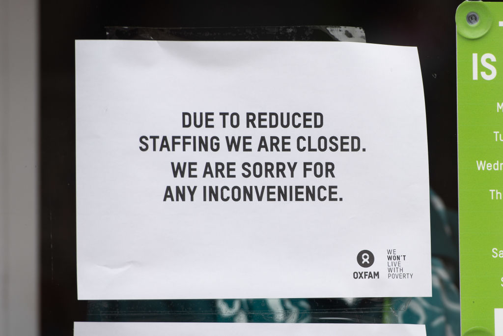 A sign in the window of an Oxfam charity shop informing of its closure due to reduced staffing on March 17, 2020 in Cardiff, United Kingdom.