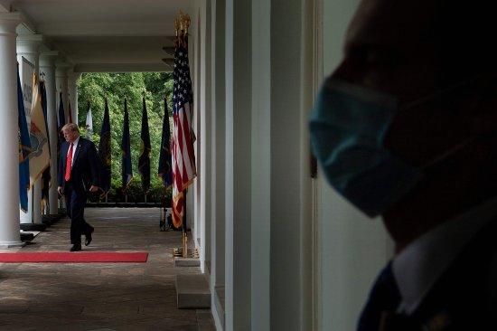 President Trump arrives at a news conference in the Rose Garden on May 11 wearing no mask, despite CDC guidelines advising Americans to use them