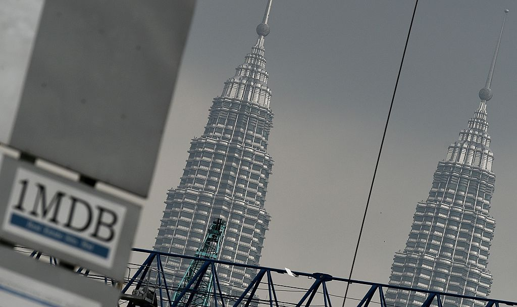 The 1 Malaysia Development Berhad (1MDB) logo is seen on a billboard at a construction site in Kuala Lumpur on July 3, 2015.