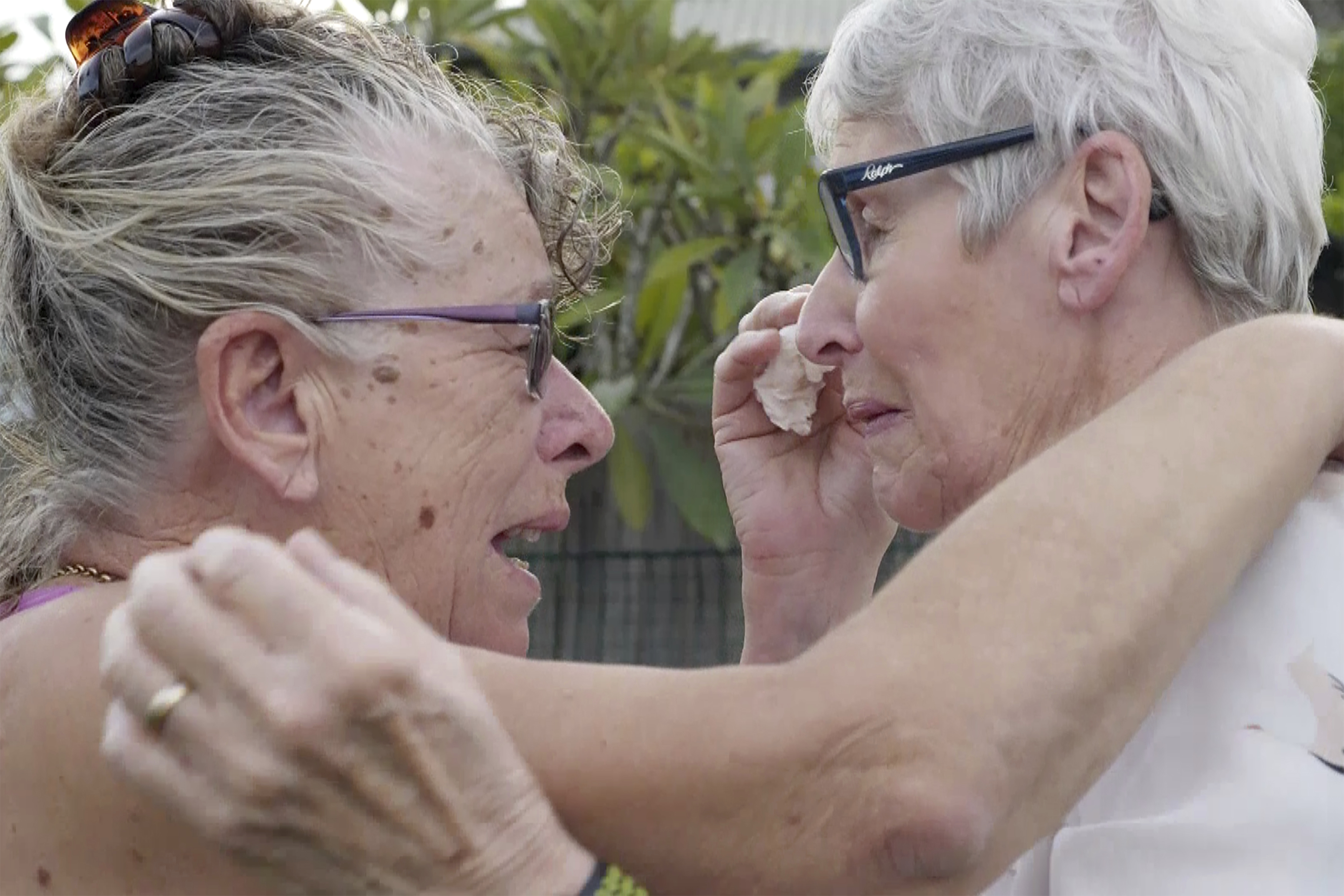 Christine Archer, right, and her sister Gail Baker cry as they are reunited in Bowraville, Australia on May 20, 2020.