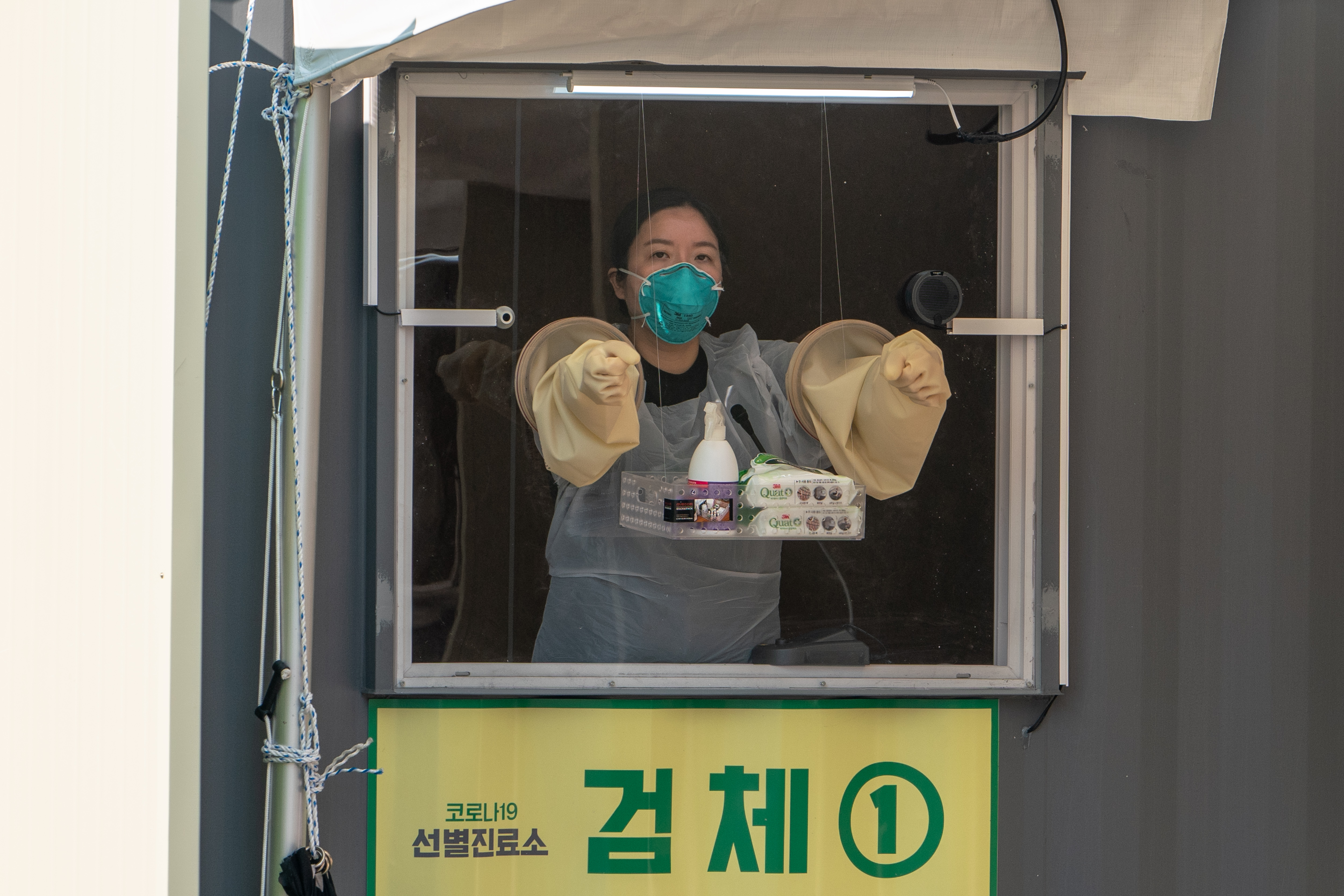 A health care worker  at the sample collection point at a  walk thru  testing center in Seoul, South Korea.