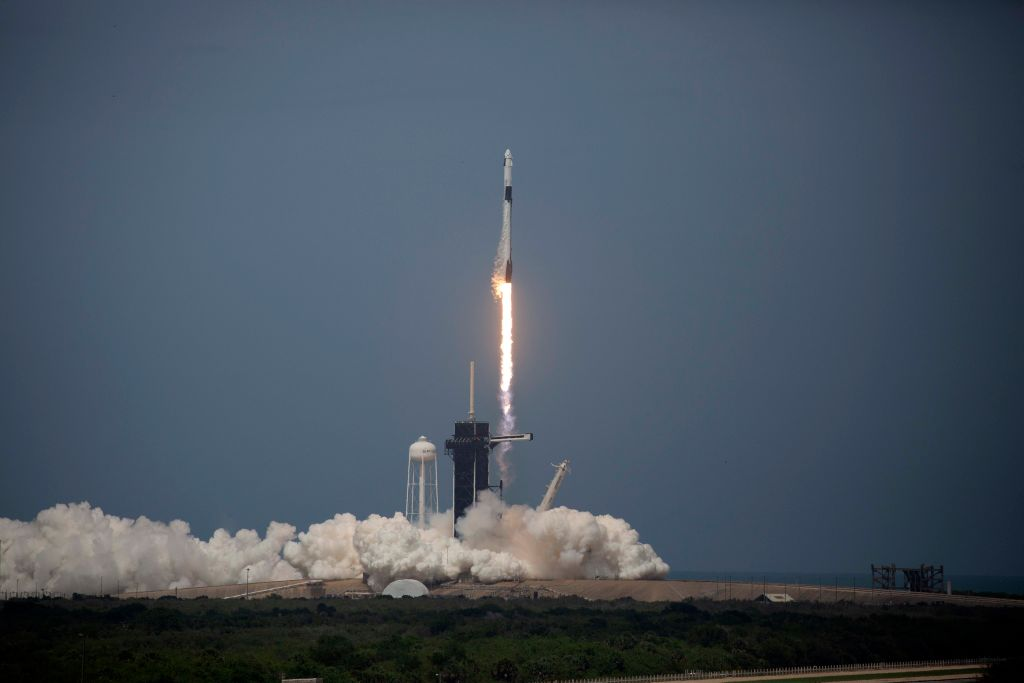 The SpaceX Falcon 9 rocket launches into space with NASA astronauts Bob Behnken (R) and Doug Hurley aboard the rocket from the Kennedy Space Center on May 30, 2020 in Cape Canaveral, Florida.