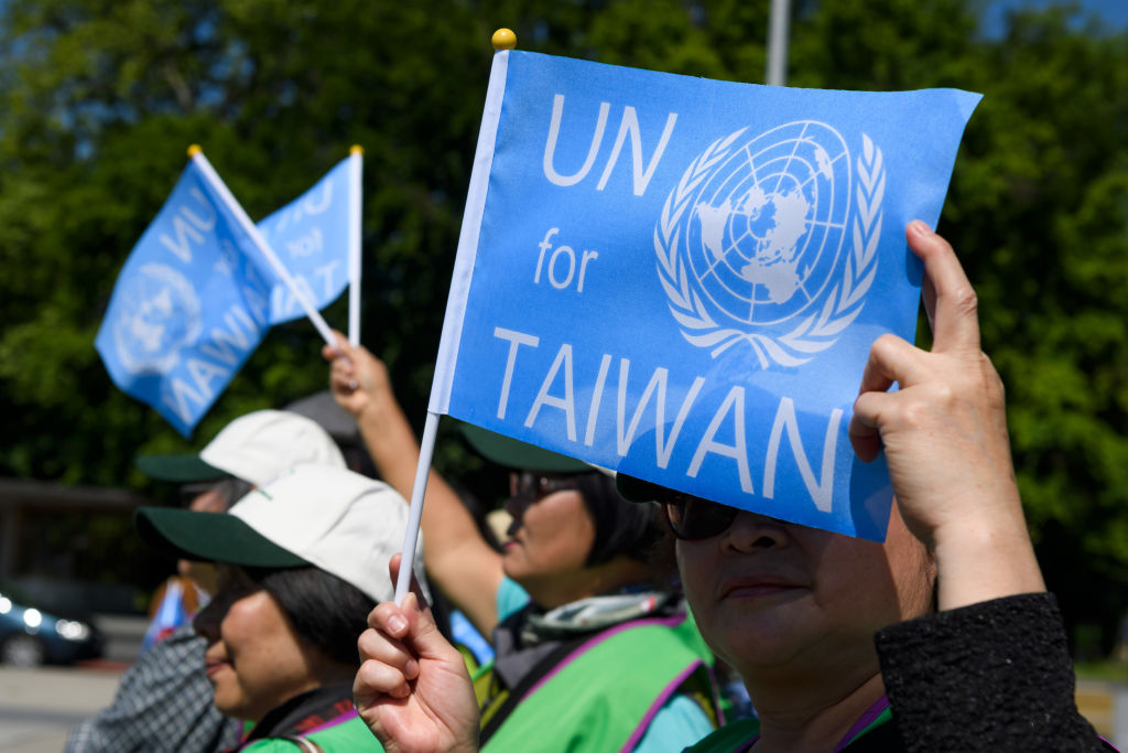 A pro-Taiwan protester holds a flag outside of the United Nations offices on the opening day of the World Health Organization's annual meeting in Geneva on May 22, 2017.