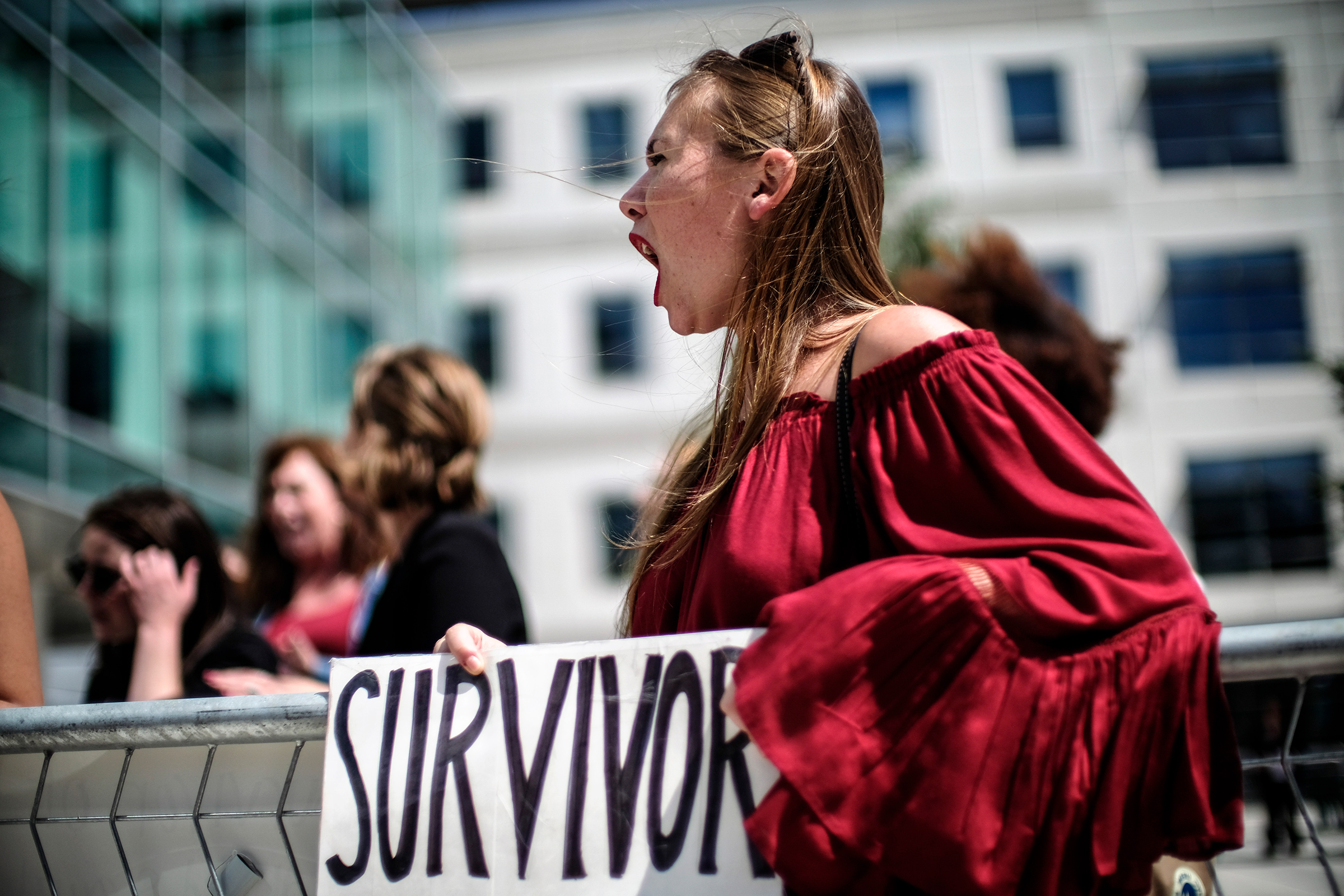 Meghan Downey protests outside as U.S. Education Secretary Betsy DeVos announces changes in federal policy on rules for investigating sexual assault reports on college campuses in Arlington, Virginia  on Sep. 7, 2017.